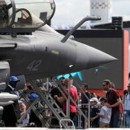 Visitors walk on the tarmac in front of  a French Dassault Aviation Rafale jetfighter on the last day of the International Paris Air Show at Le Bourget Airport, near Paris, on June 25, 2017. This show is the most important expo of its kind in the world, br