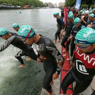 Competitors dive in the Bassin de La Villette during the swim section of the 2017 edition of the Paris triathlon on July 2. 2017 in Paris. An unprecedented course located amidst the most beautiful monuments in Paris and setting out from Bassin de La Villet