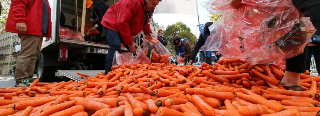 Tobacconists throw carrots on the street as they demonstrate against the increase to 10 euros of the price of a packet of cigarettes, scheduled by the government for 2020, on October 4, 2017 in Paris. The carrot is a reference to the name of the red diamon