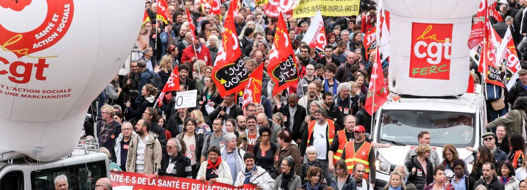 Thousands of public sector workers march through Paris on October 10, 2017, as part of a nationwide strike organized by the country's nine major labor unions against the flagship labor reforms of French President Emmanuel Macron which plans to freeze pay,