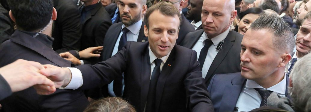 French President Emmanuel Macron (C) visits the 55th International Agriculture Fair (Salon de l'Agriculture) at the Porte de Versailles exhibition center in Paris, on February 24, 2018. He had a tense exchange with cereal producers loudly protesting his go