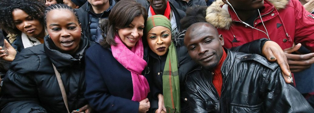 """Paris Mayor Anne Hidalgo (with pink scarf) is seen during the inauguration of the new """"Paris Respire"""" zone in Château Rouge in Paris, France on March 10, 2018. This is the first implementation of the """"All mobilized for our neighborhood"""" program to reserve"""