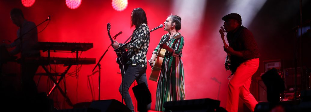 French singer Catherine Ringer,(C), the icon of '80s French Synth-Pop band « Les Rita Mitsouko », performs on stage during the Festival of Humanity (Fete de l'Humanité), a political event and music festival organised by the French Communist party (PCF