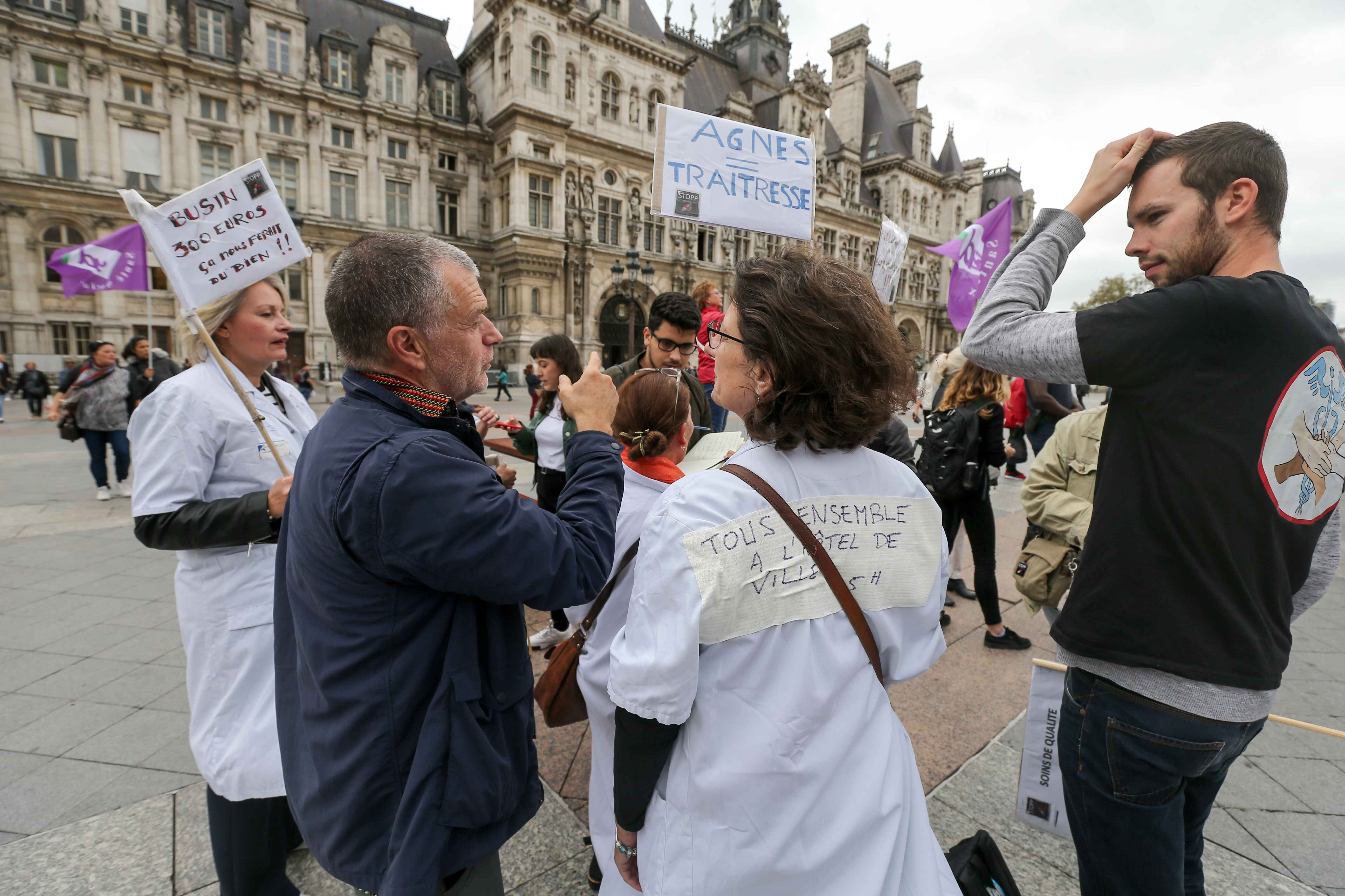 Doctors, nurses and cargivers gather in Paris in front the Hotel de Ville, outside the headquarter of Assistance publique and Hôpitaux de Paris or AP-HP, public hospital system of Paris, to improve the working conditions in the French emergencies services