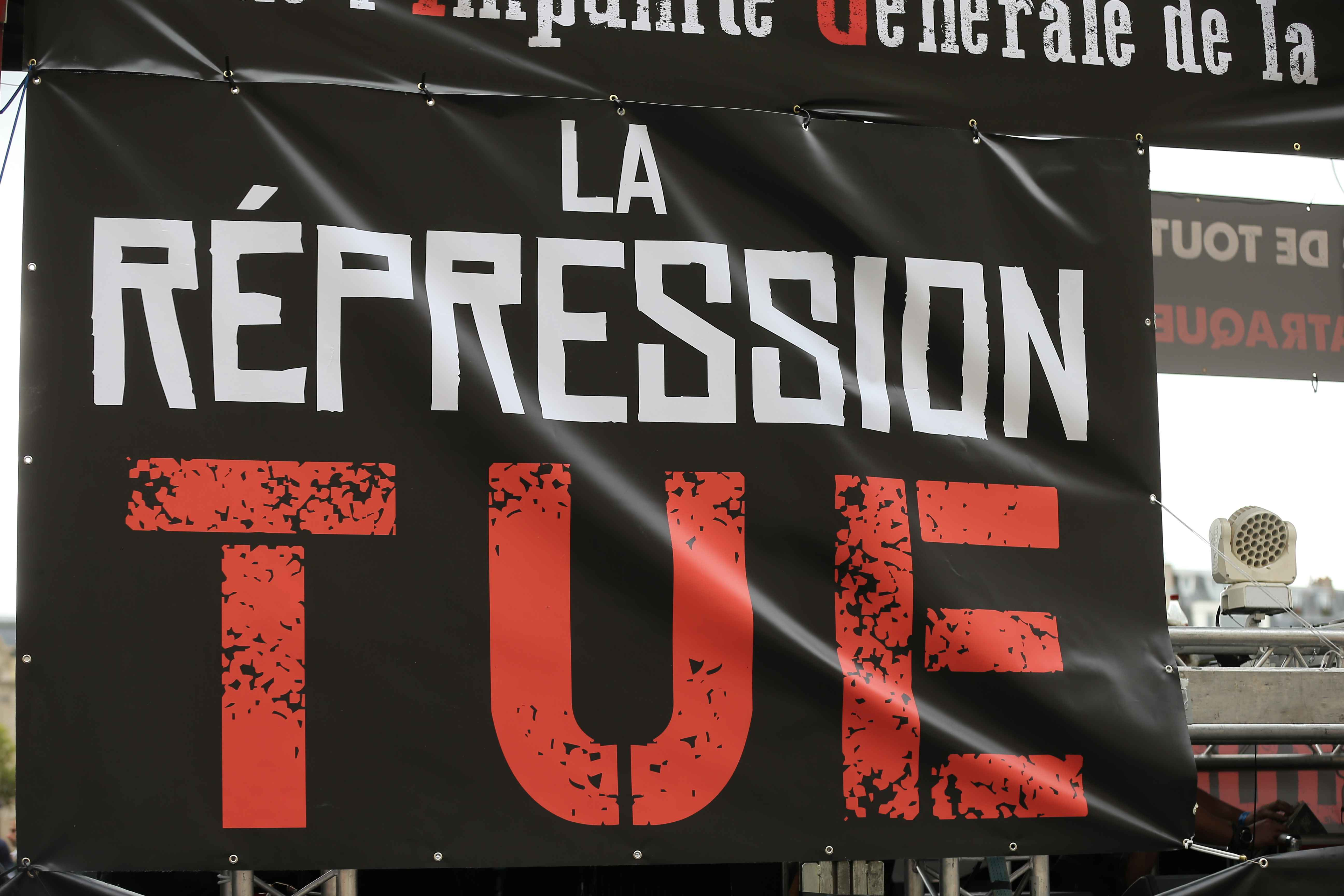 People take part in the 21st annual Techno Parade in Paris, on September 28, 2019. A banner on a float reading : « The repression kills ». This year parade was dedicated to the memory of Steve Canico, a young techno fan who went missing on June 21, 2019