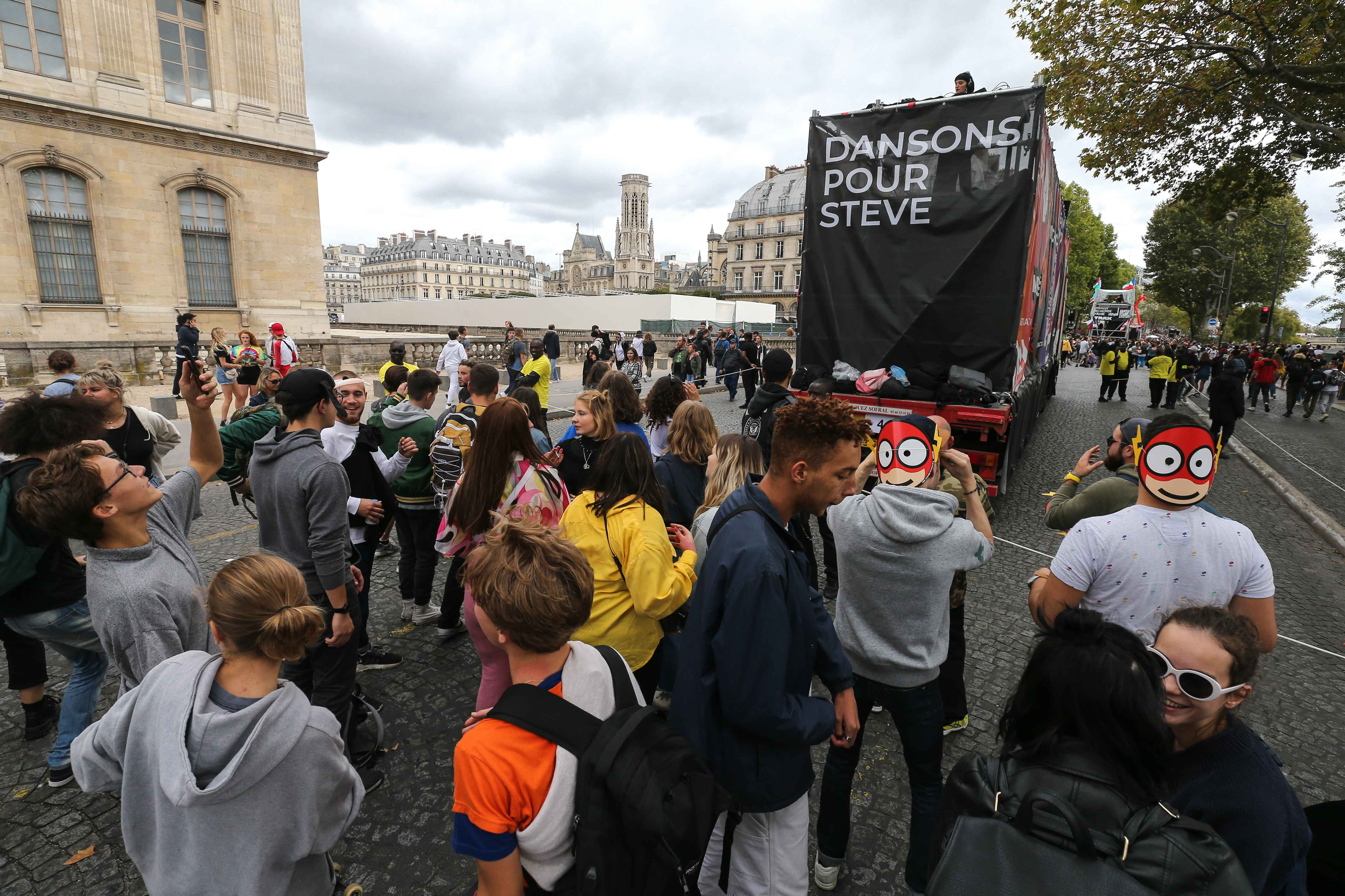 People take part in the 21st annual Techno Parade in Paris, on September 28, 2019. A banner on a float reading : « Let's dance for Steve ». This year parade was dedicated to the memory of Steve Canico, a young techno fan who went missing on June 21, 20