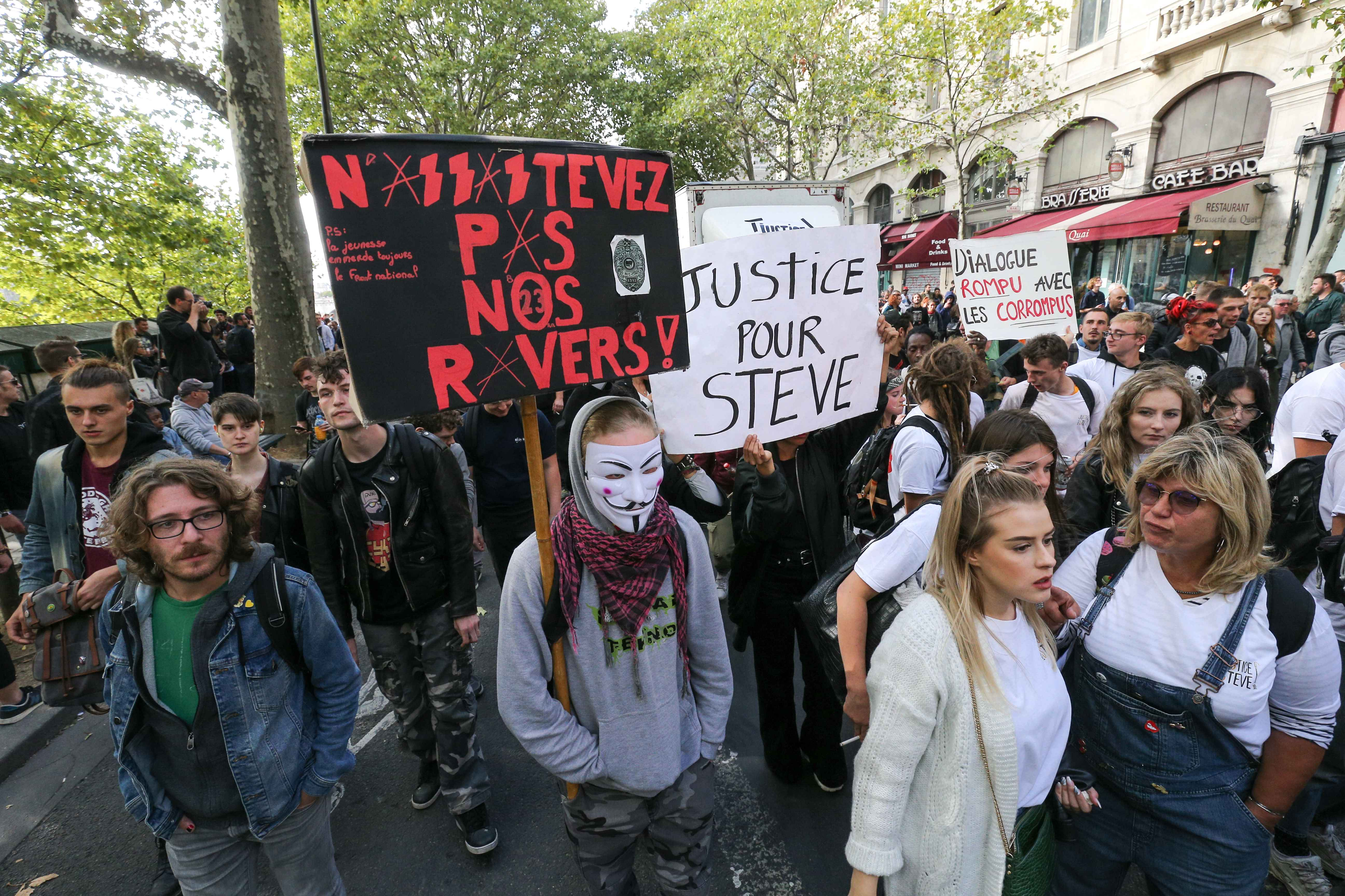People take part in the 21st annual Techno Parade in Paris, on September 28, 2019. They carry a banner  reading : « Justice for Steve ». This year parade was dedicated to the memory of Steve Canico, a young techno fan who went missing on June 21, 2019 at