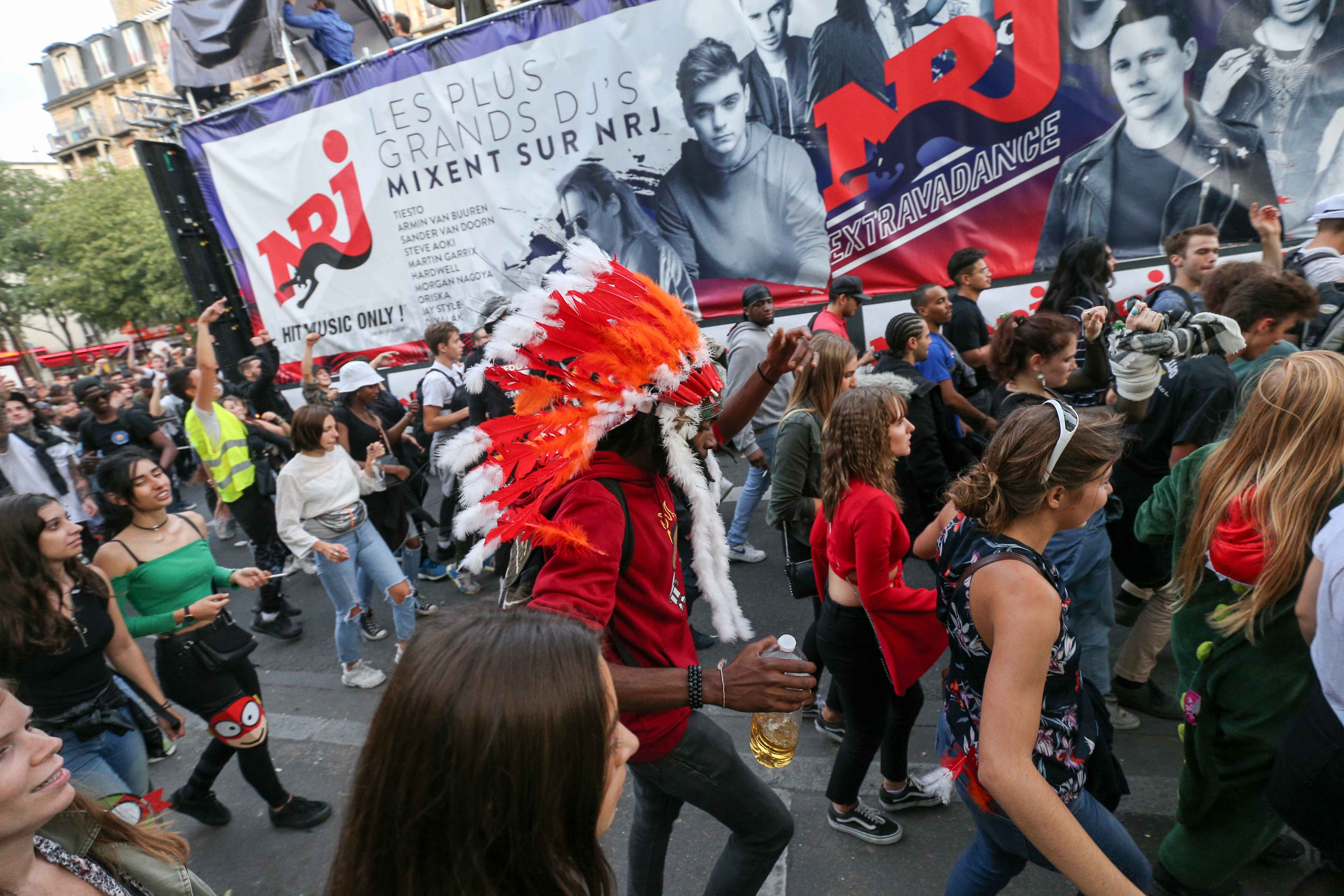 People take part in the 21st annual Techno Parade in Paris, on September 28, 2019. This year parade was dedicated to the memory of Steve Canico, a young techno fan who went missing on June 21, 2019 at an island rave in Nantes, western France, that ended in
