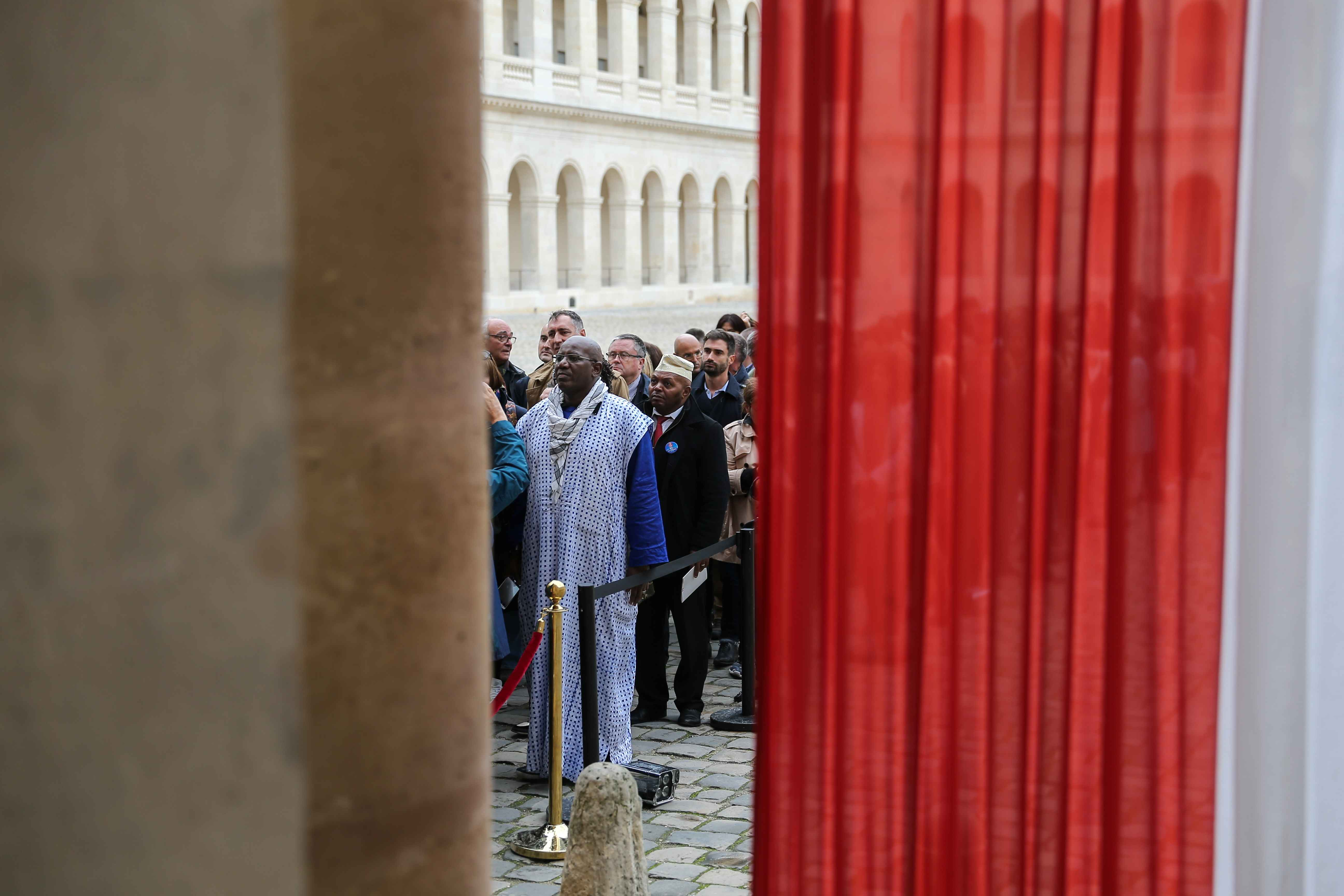 People queue to say a final farewell to former French President Jacques Chirac as the coffin lie in state at the Saint-Louis-des-Invalides cathedral at the Invalides memorial complex in central Paris on September 29, 2019. Jacques Chirac died on September