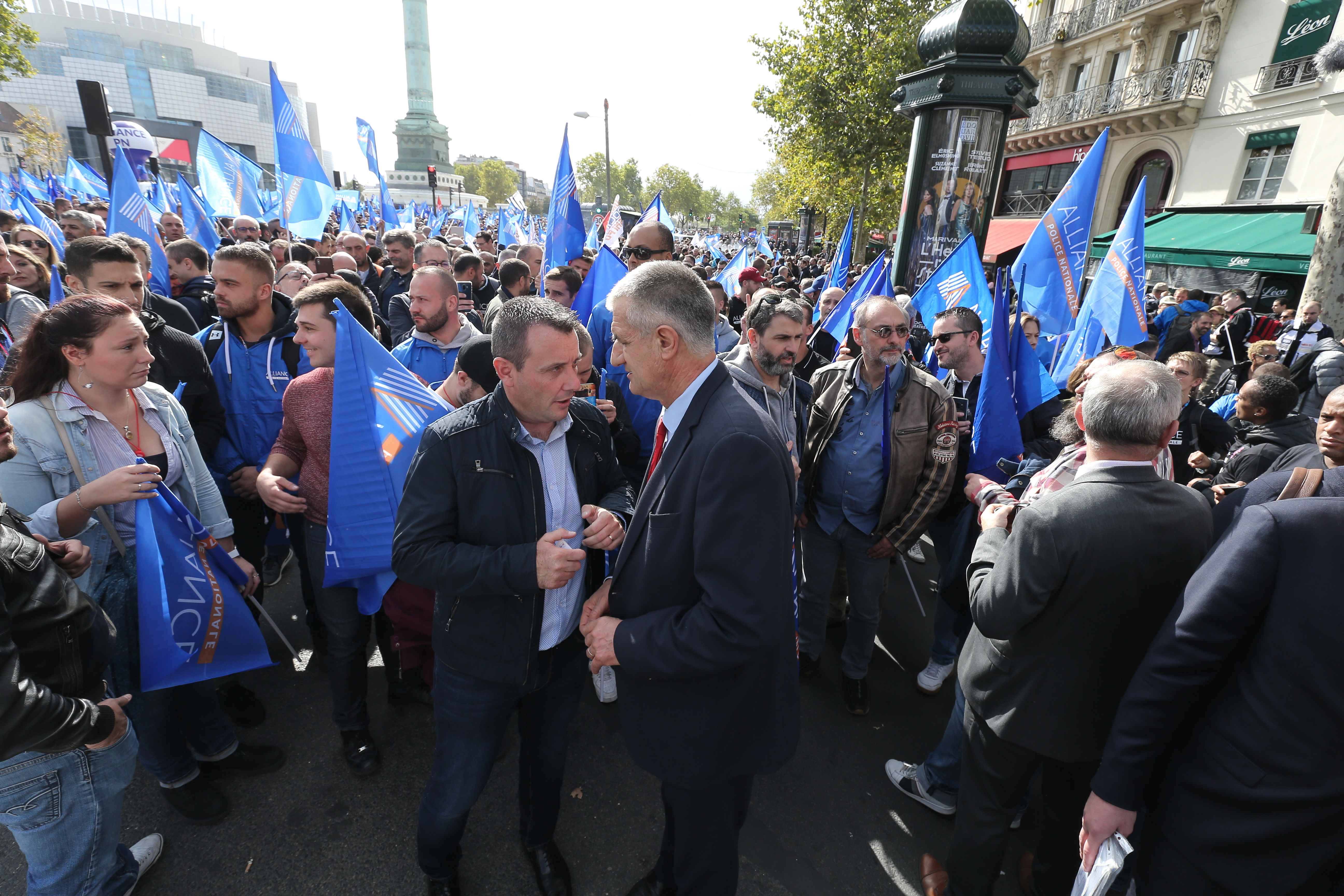 French Member of Parliament Jean Lassalle (C, red tie) speaks with Fabien Vanhemelryck (C), Secretary General of the Alliance-Police Nationale Union, during the ''Walk of Wrath'' of the Policemen in Paris (France) on October 2, 2019. At the call of the Nat