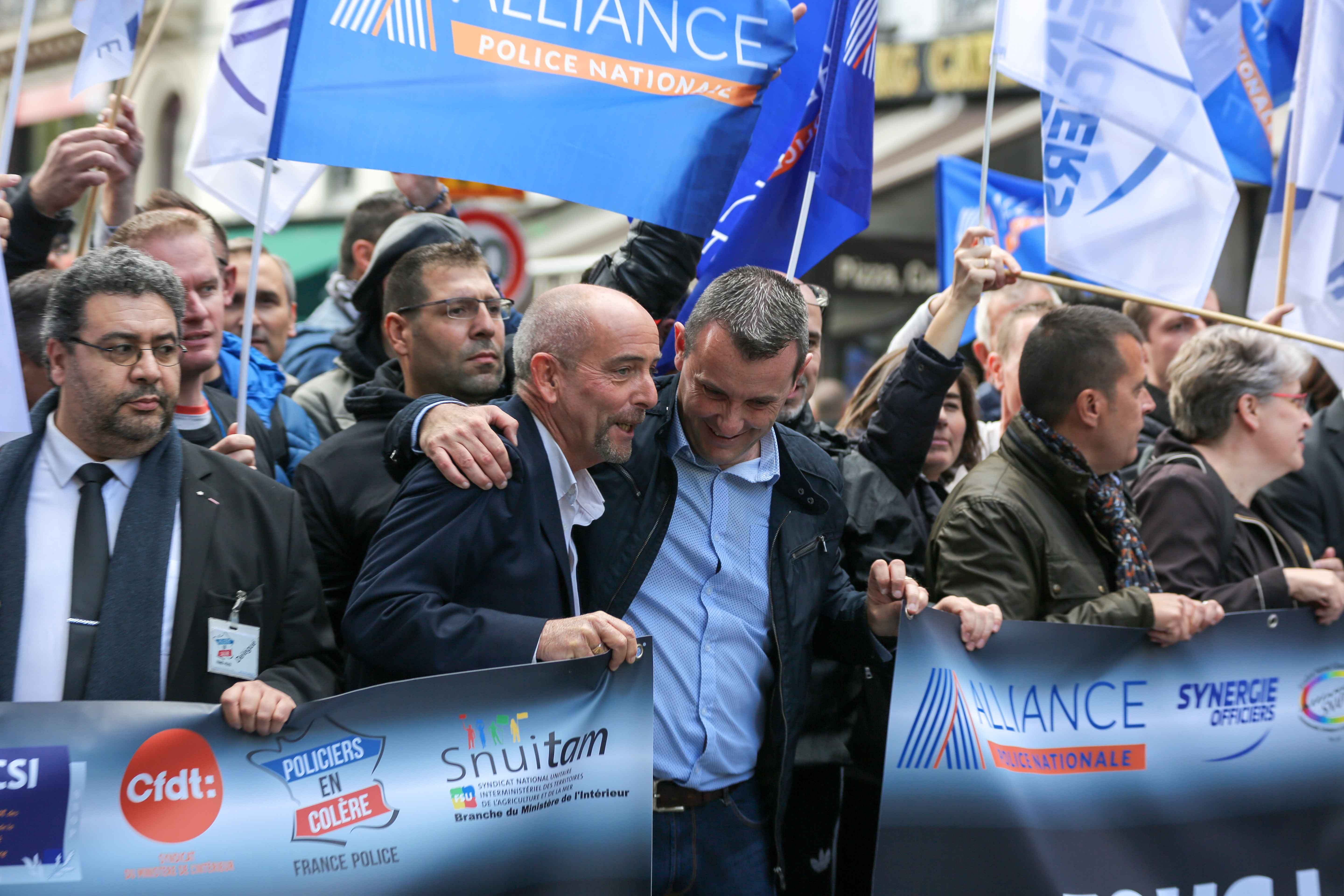 Yves Lefebvre (3L), general secretary of the Unite SGP-Police union, speaks with Fabien Vanhemelryck(4L), Secretary General of the Alliance-Police Nationale Union, during the ''Walk of Wrath'' of the Policemen in Paris on October 2, 2019. At the call of th