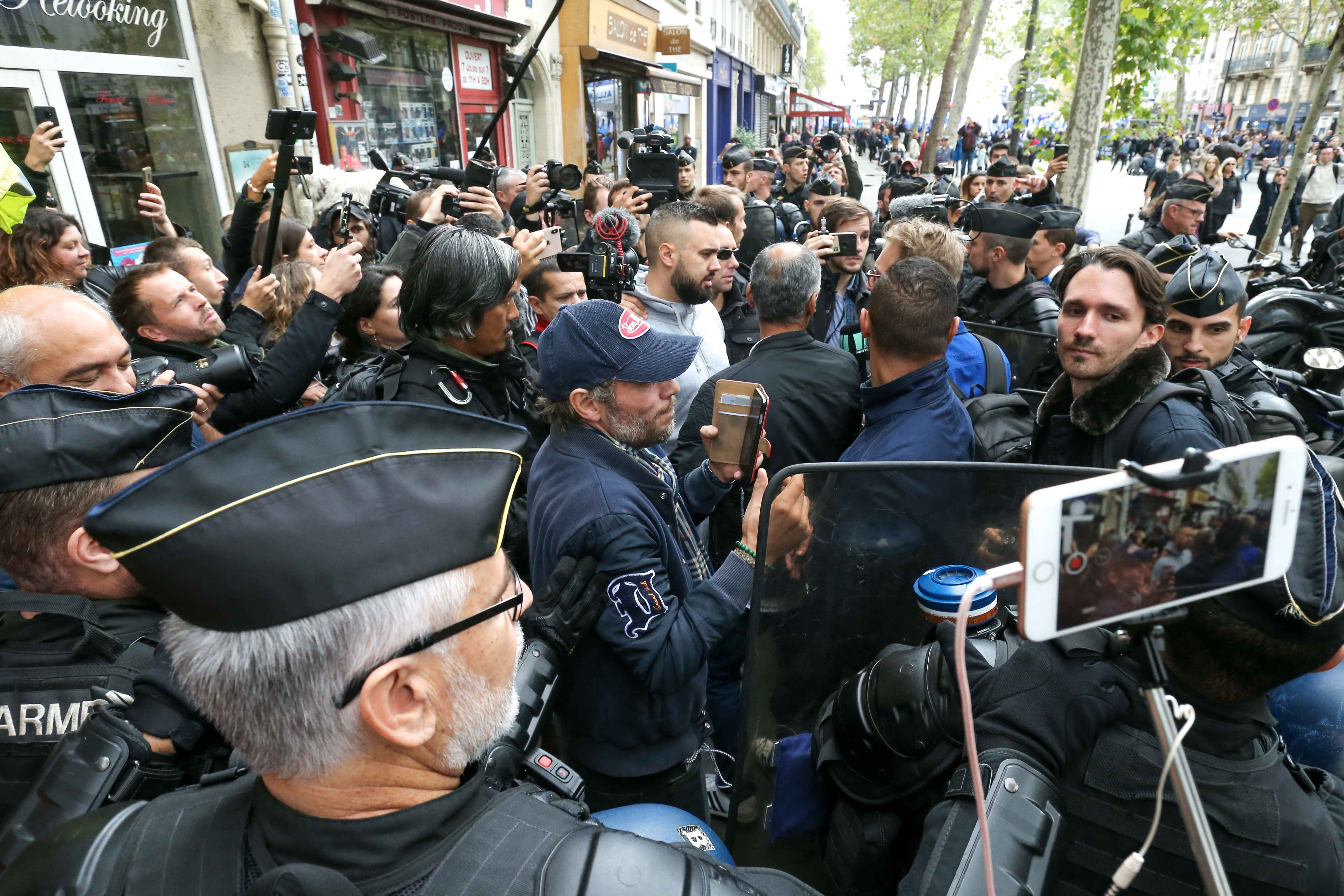 Eric Drouet (C, grey sweatshirt), one of the leading figures of the 'Yellow Vest' (gilet jaune) movement, speaks to journalists during the ''Walk of Wrath'' of the Policemen in Paris (France) on October 2, 2019. At the call of the National Police unions, s