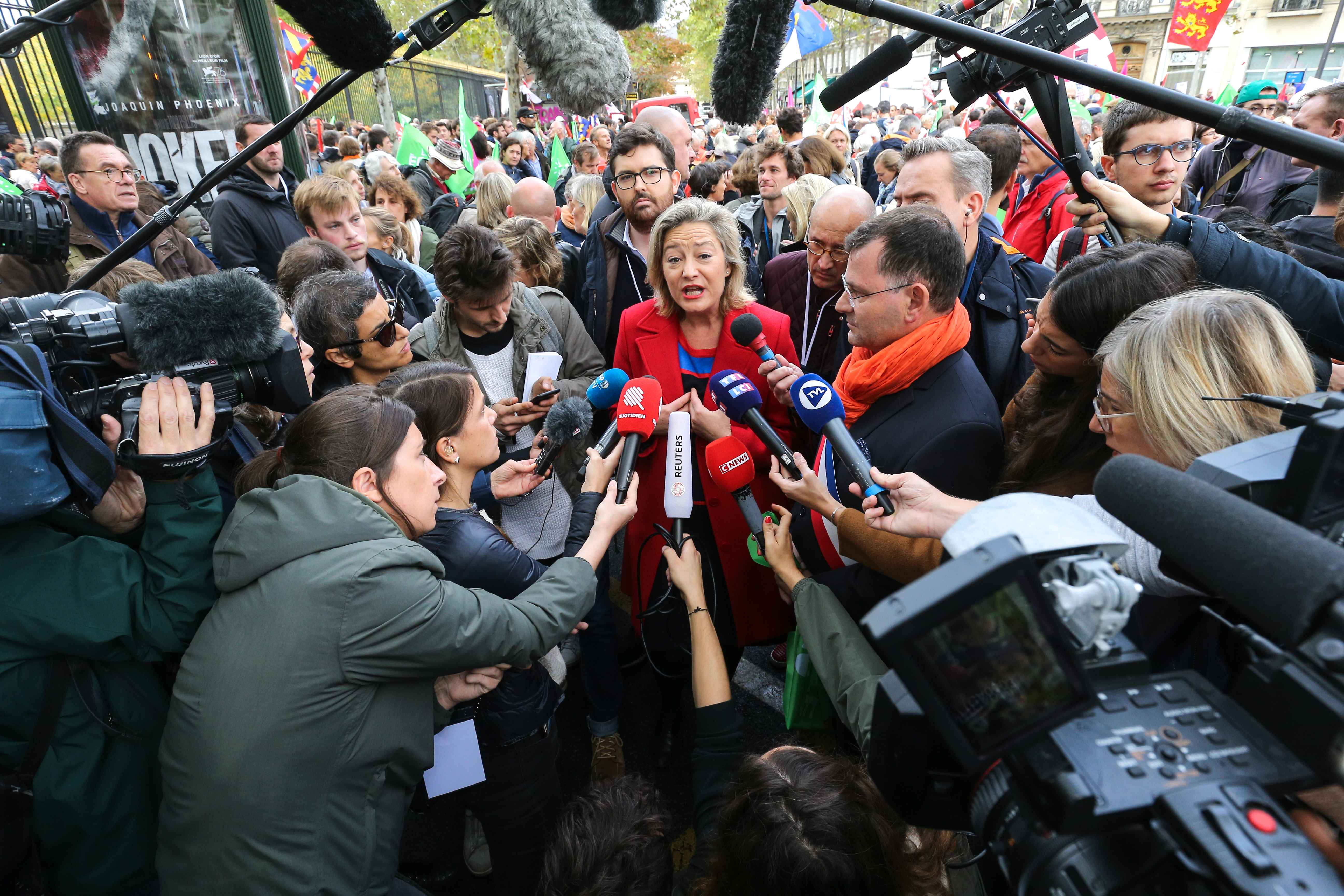 "President of the anti-gay marriage movement ""La Manif Pour Tous"" (Protest for Everyone) Ludovine de la Rochere (C) talks to the press during a protest against a government plan to let single women and lesbians become pregnant with fertility treatments, on"