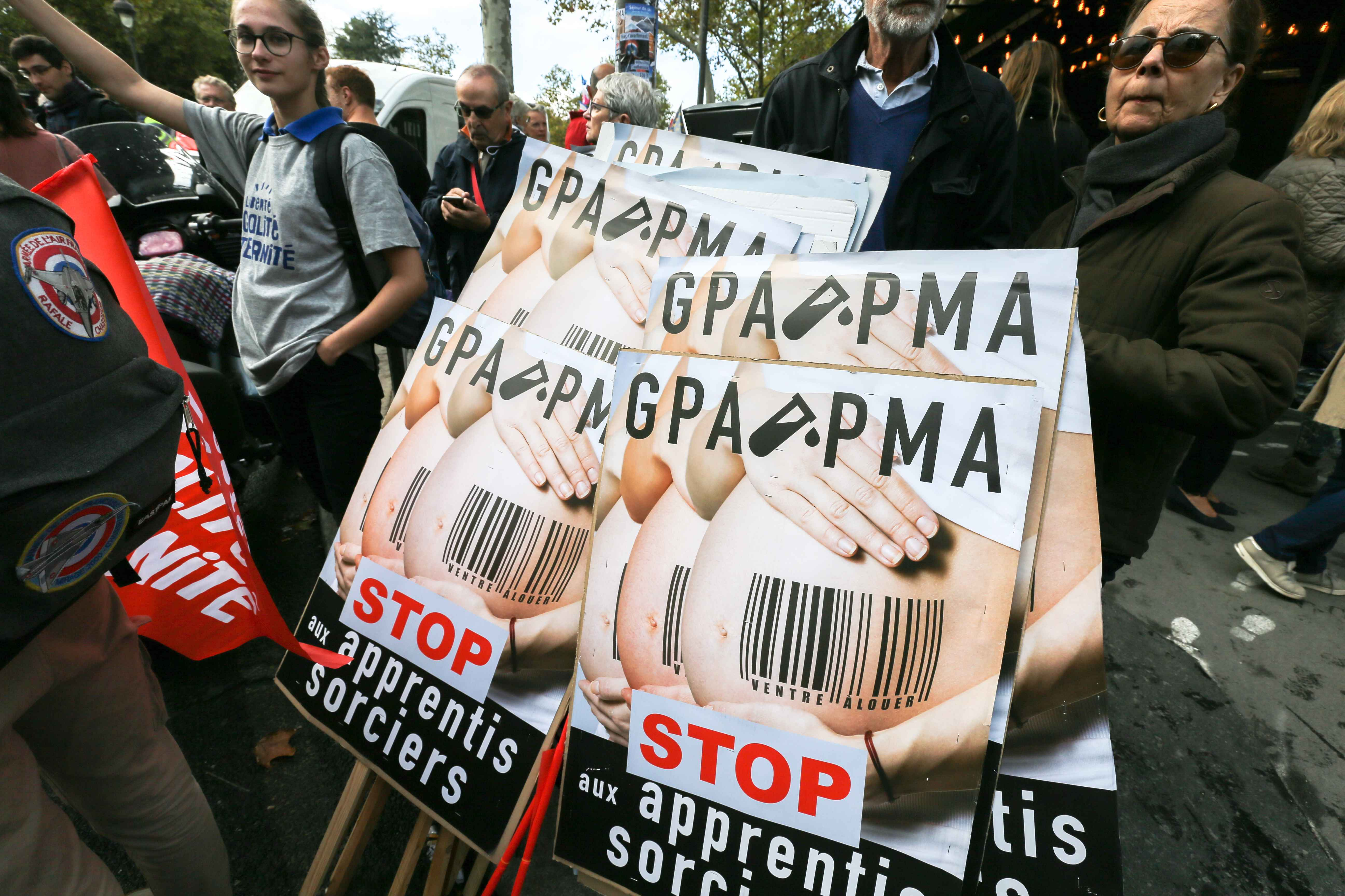 Signs against the PMA (Medically Assisted Reproduction) for all women and the GPA (Surrogacy) during a protest against a government plan to let single women and lesbians become pregnant with fertility treatments, on October 6, 2019 in Paris. The French Nat