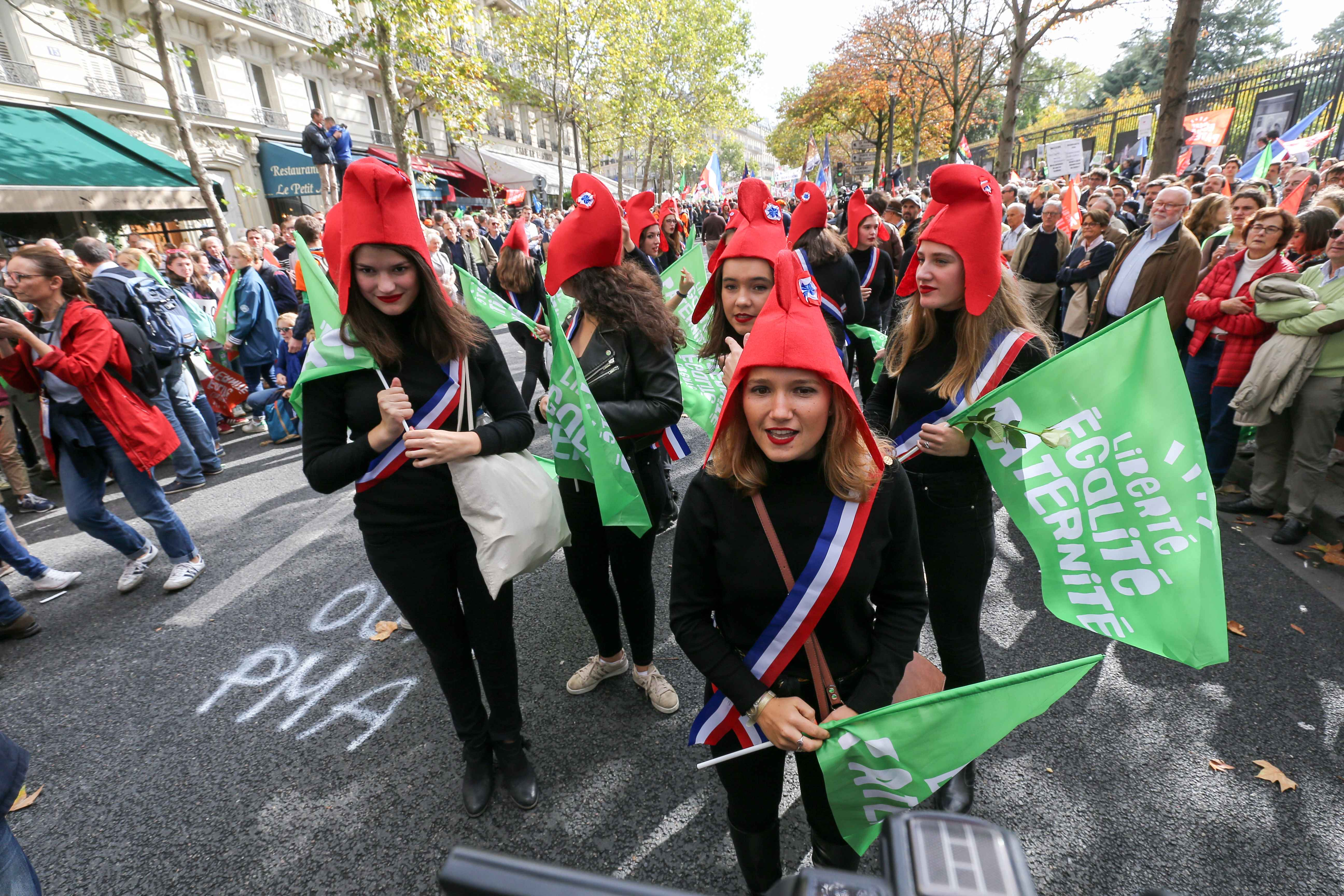 Young girls wearing a Phrygian cap symbolizing the French Republic take part in a protest against a government plan to let single women and lesbians become pregnant with fertility treatments, on October 6, 2019 in Paris. The French National Assembly on Sep