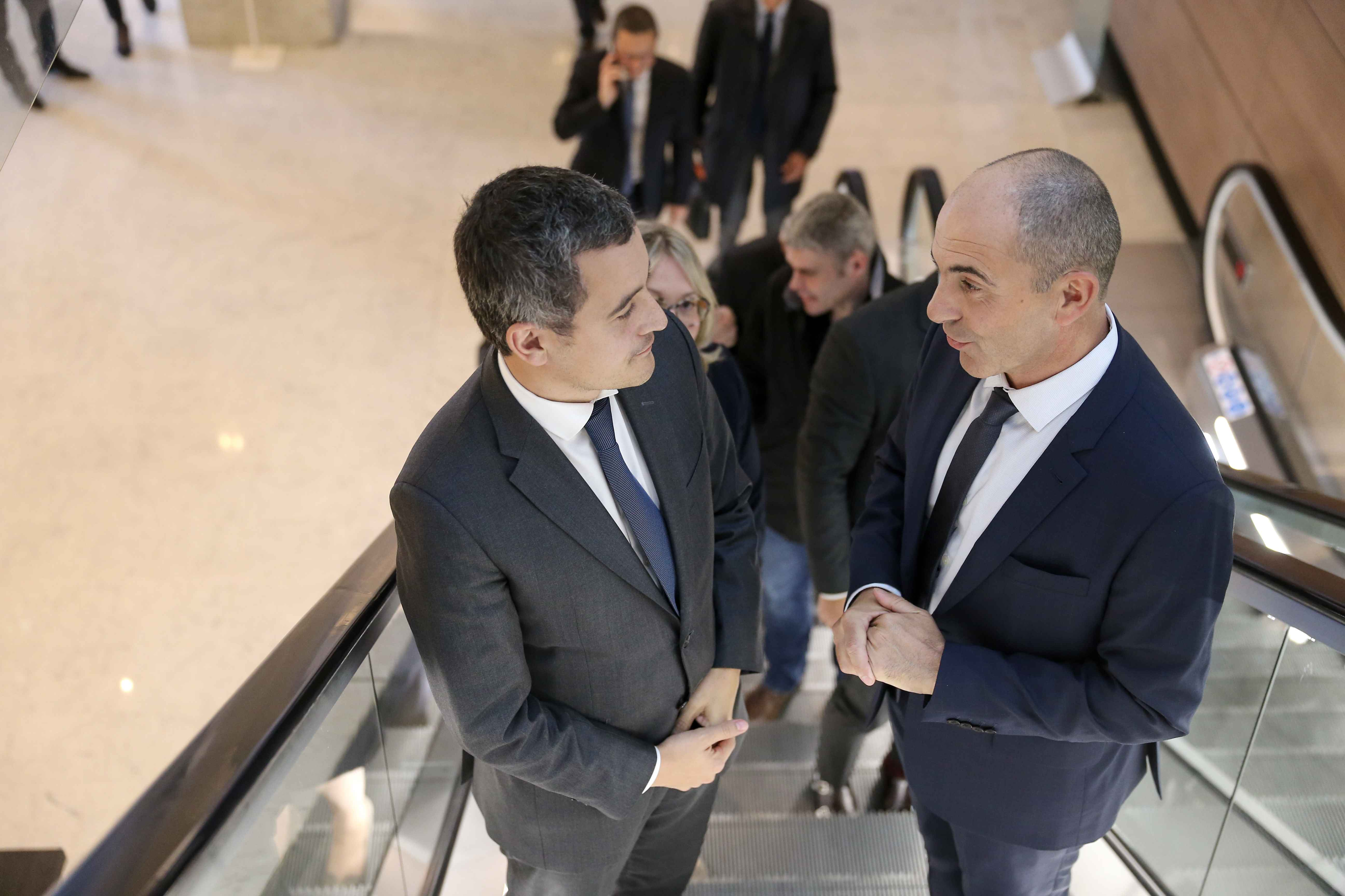 French Minister for Public Action and Accounts Gerald Darmanin (L) is welcomed by Philippe Coy (R), President of the National Tobacconists  Confederation, during the Congress of the Confederation in Paris, on October 10, 2019. In the last few years, the in