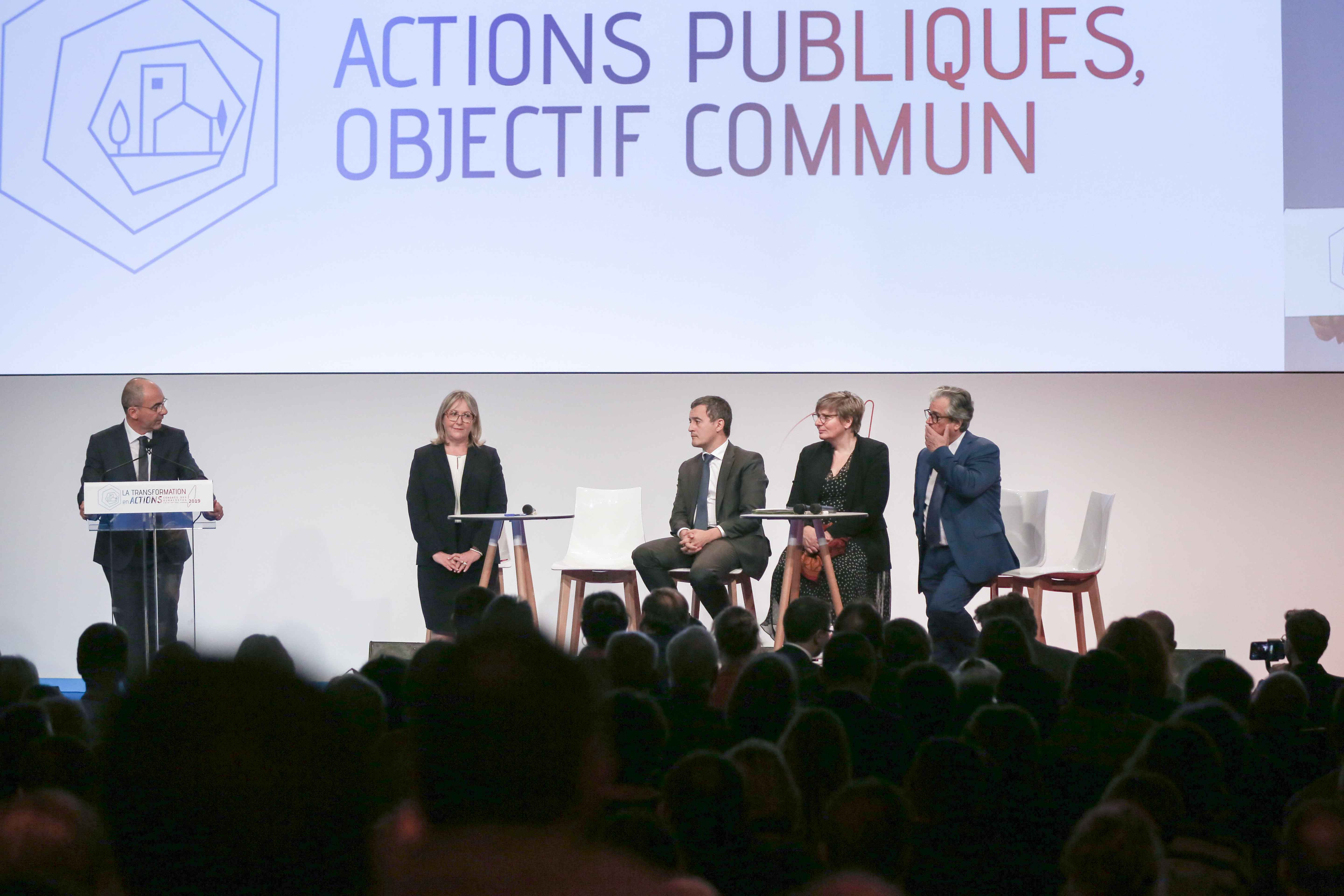 Philippe Coy (L), President of the National Tobacconists  Confederation, adresses tobacconists, in front of French Minister for Public Action and Accounts Gerald Darmanin (3R), during the Congress of the Confederation in Paris, on October 10, 2019. In the