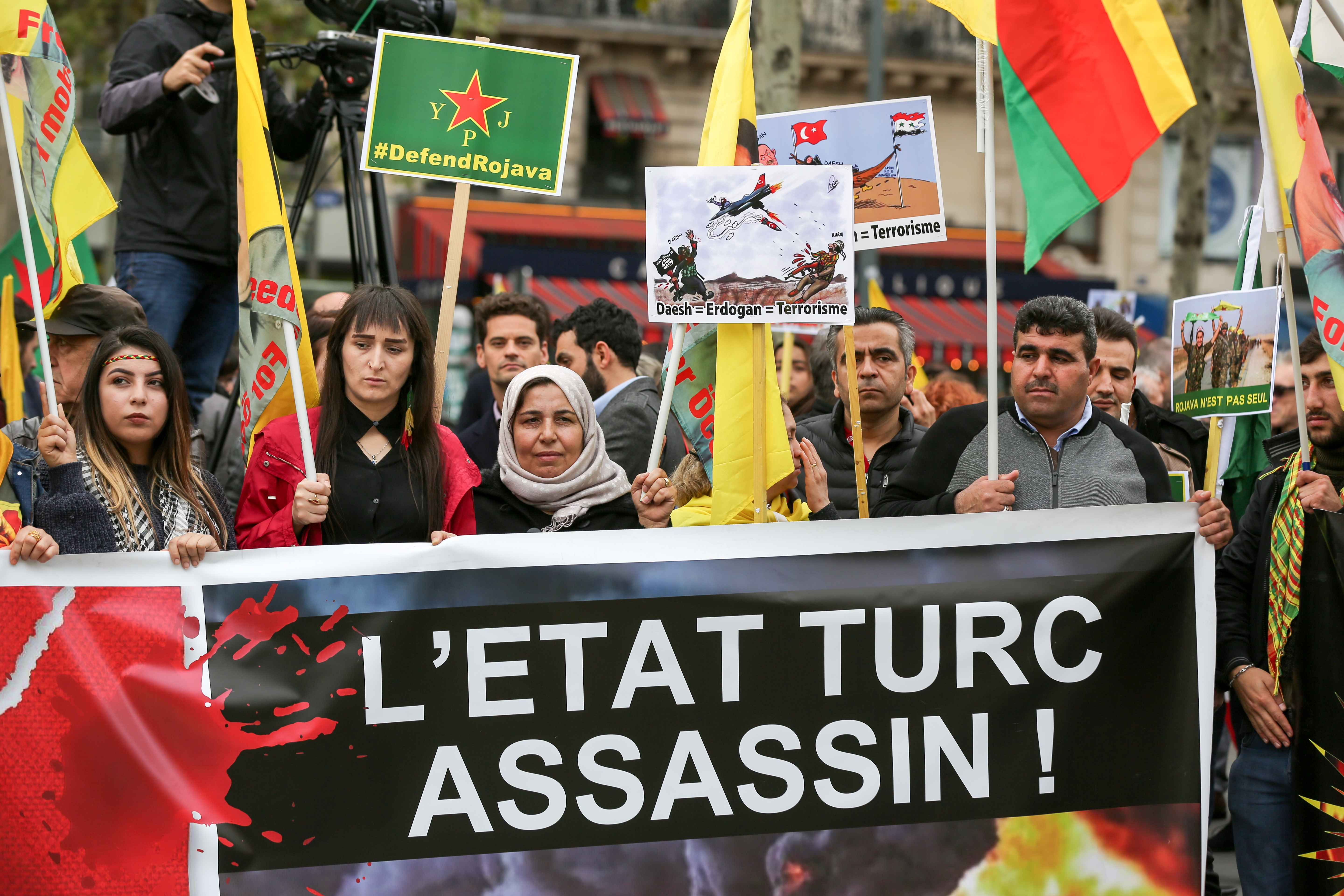People hold a banner reading « The Turkish State is murderer » during a demonstration at the place de la Republique in Paris, on October 12, 2019, in support of the Kurds and against the Turkish offensive in Syria. On October 9, 2019, the Turkish militar