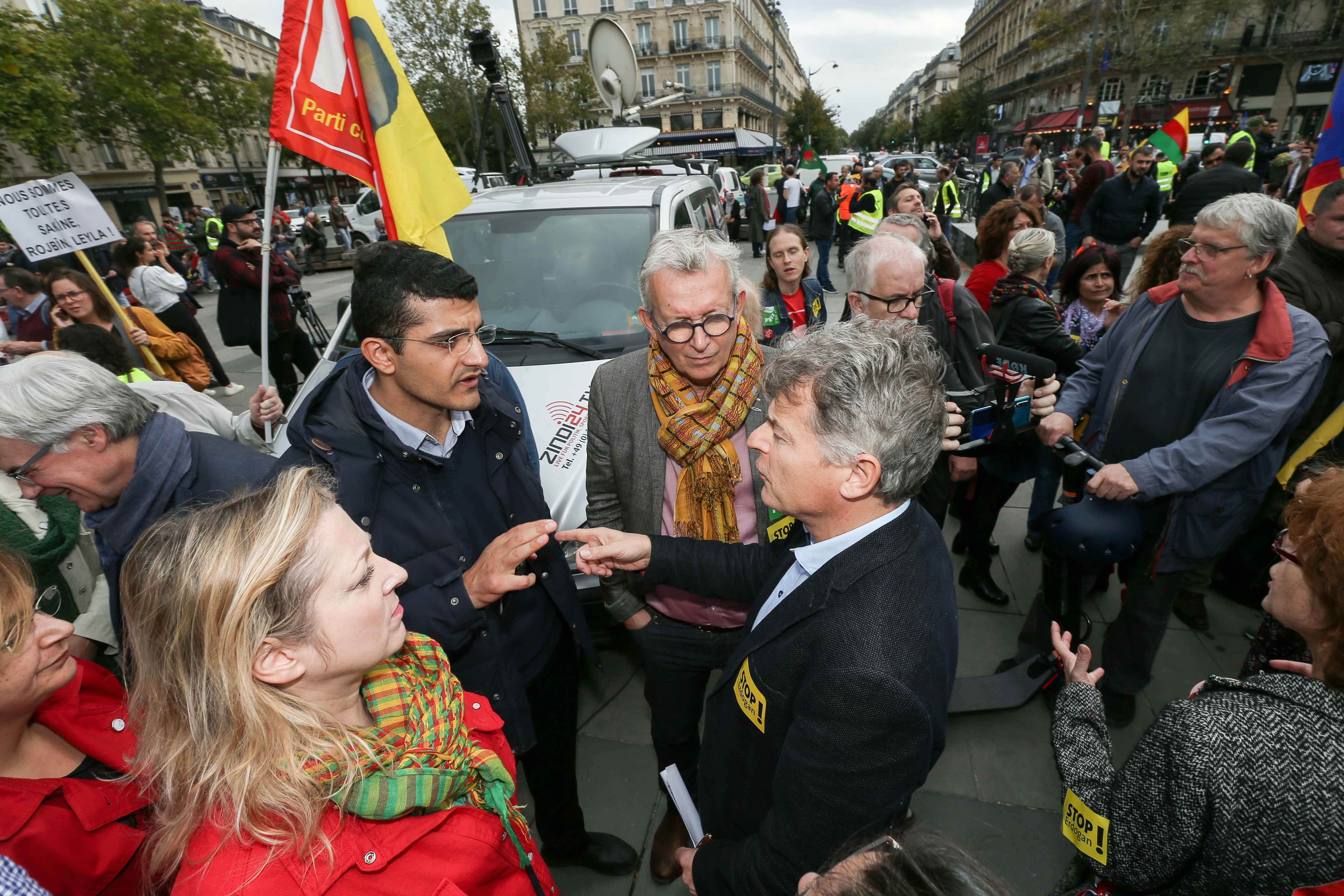 Former French Communist Party (PCF) national secretary Pierre Laurent (C) and PCF national secretary Fabien Roussel (CR), take part on October 12, 2019 in Paris in a demonstration in support of the Kurds and against the Turkish offensive in Syria. On Octob