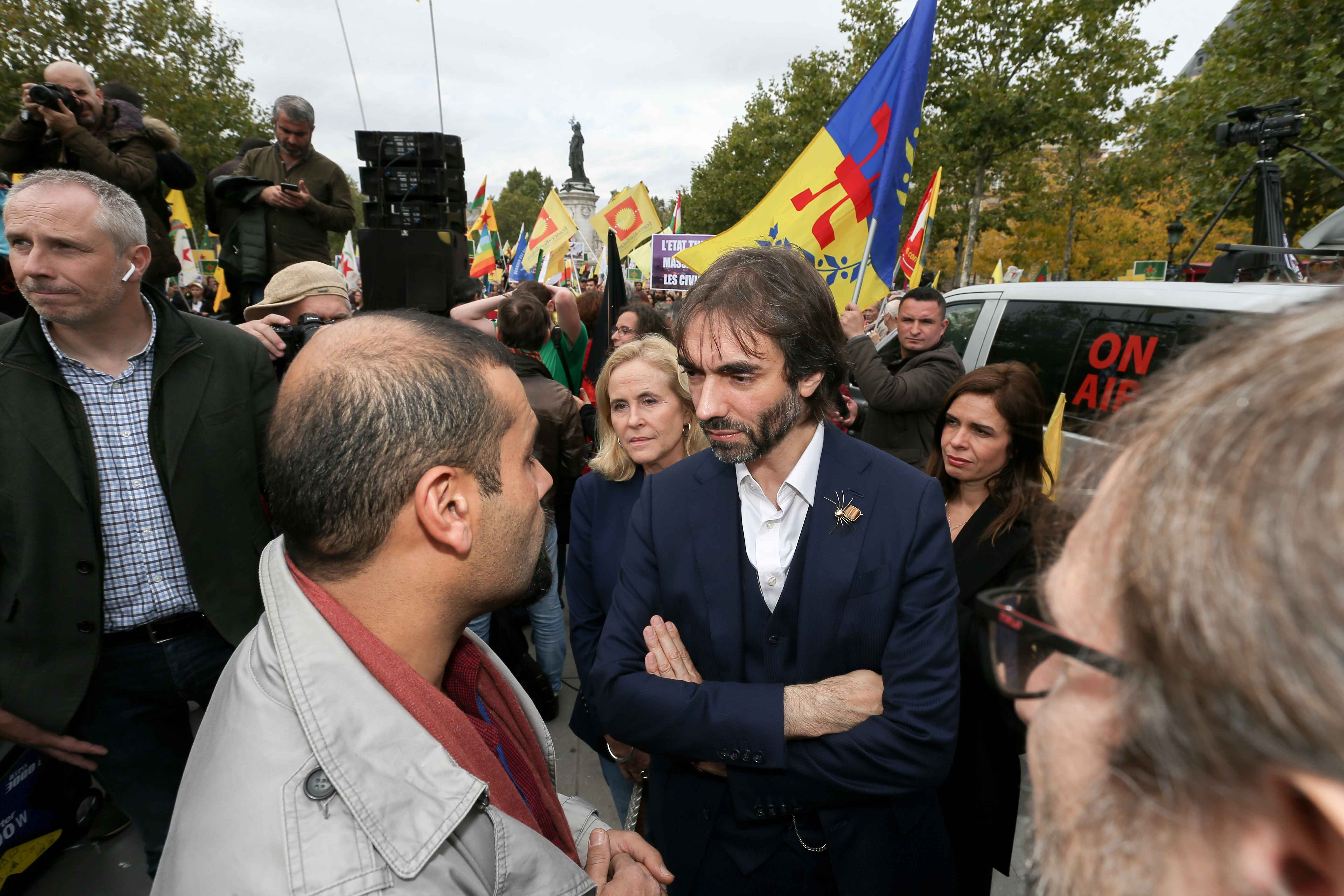 French member of Parliament and candidate for Paris' mayoral election, mathematician Cedric Villani (C) takes part on October 12, 2019 in Paris in a demonstration in support of the Kurds and against the Turkish offensive in Syria. On October 9, 2019, the T