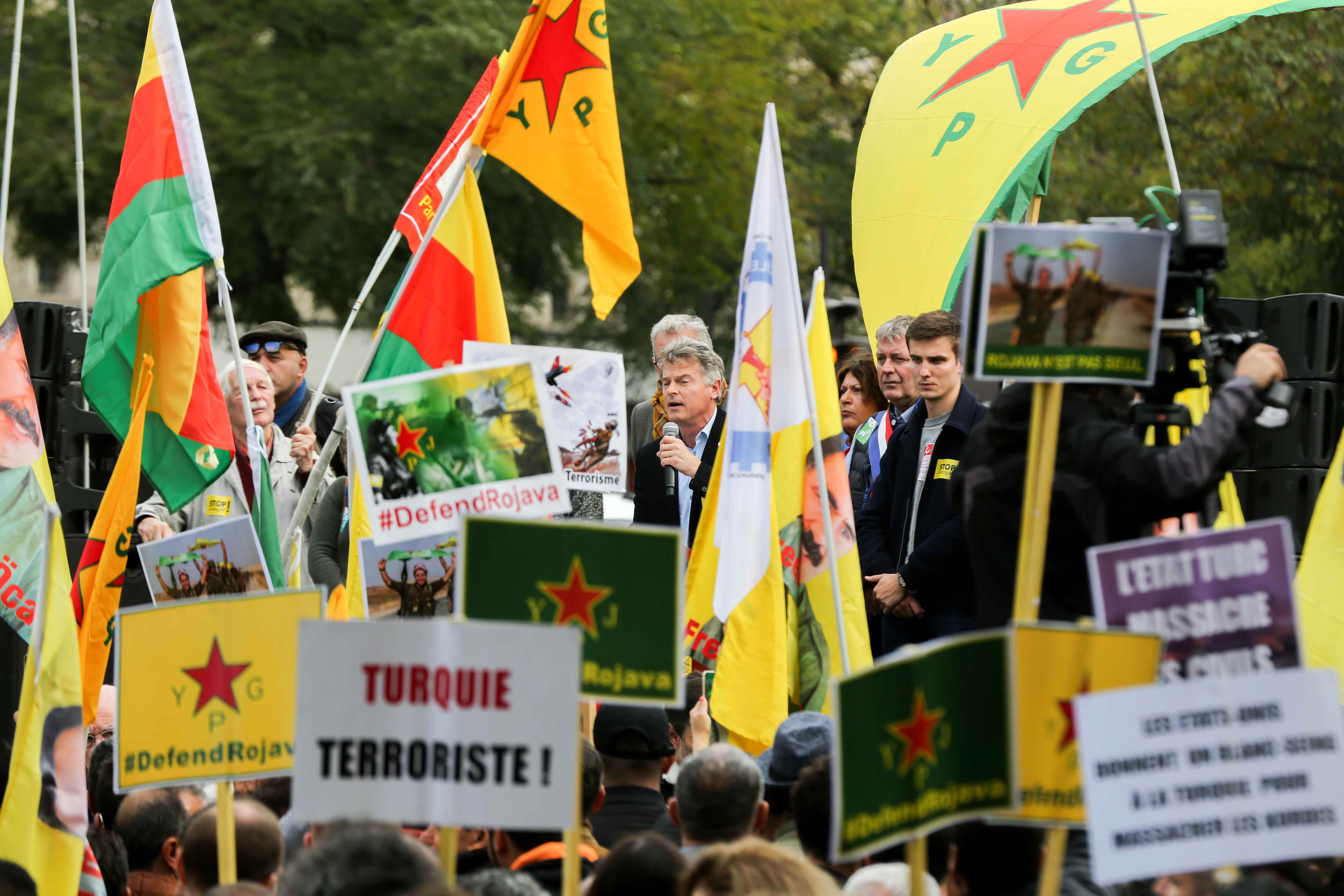 French Communist Party (PCF) national secretary Fabien Roussel (C) adresses people on October 12, 2019 in Paris during a demonstration in support of the Kurds and against the Turkish offensive in Syria. On October 9, 2019, the Turkish military began its as