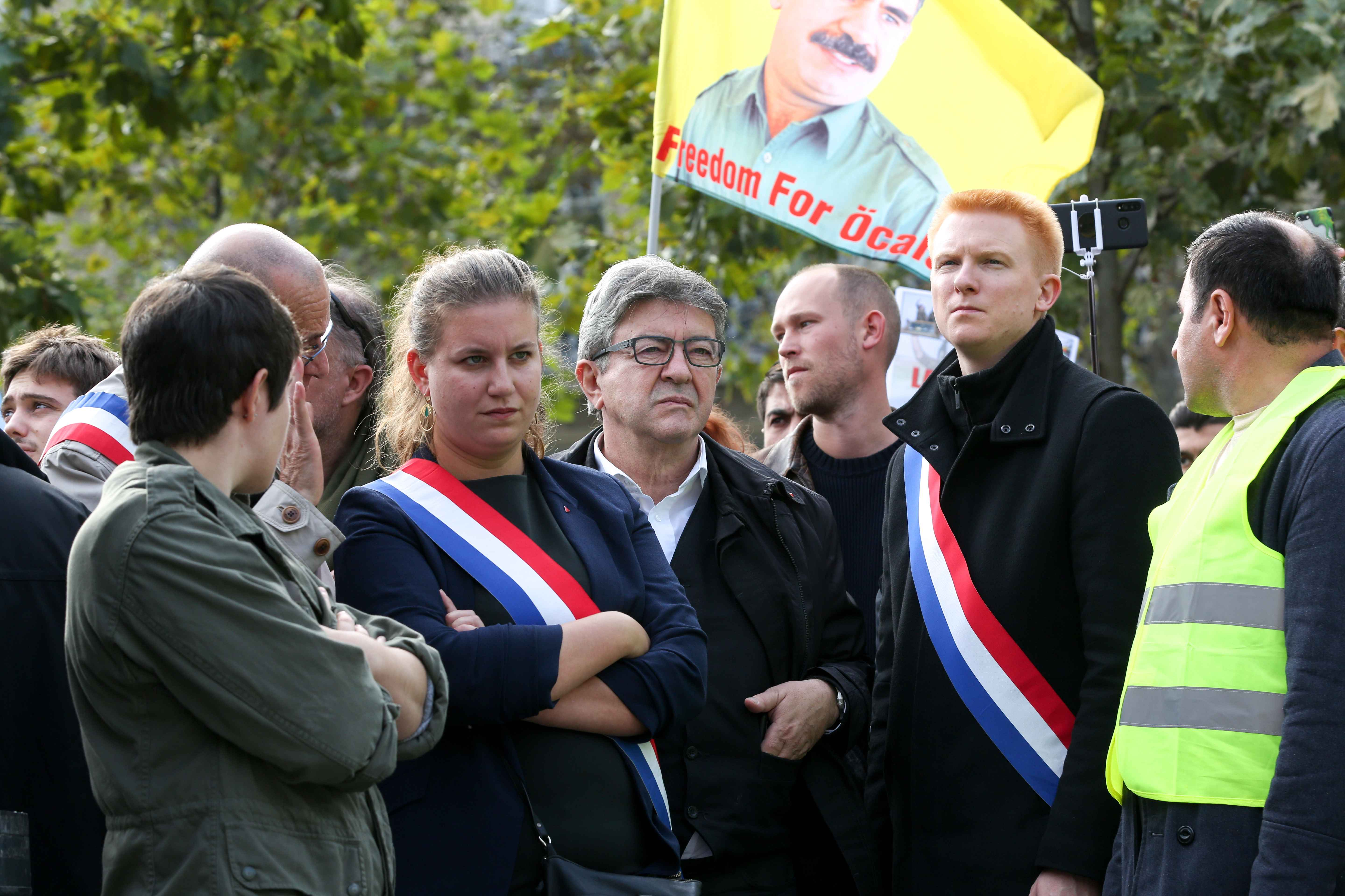 French member of Parliament and president of the leftist La France Insoumise (LFI) party Jean-Luc Melenchon (C) takes part on October 12, 2019 in Paris in a demonstration in support of the Kurds and against the Turkish offensive in Syria. On October 9, 201