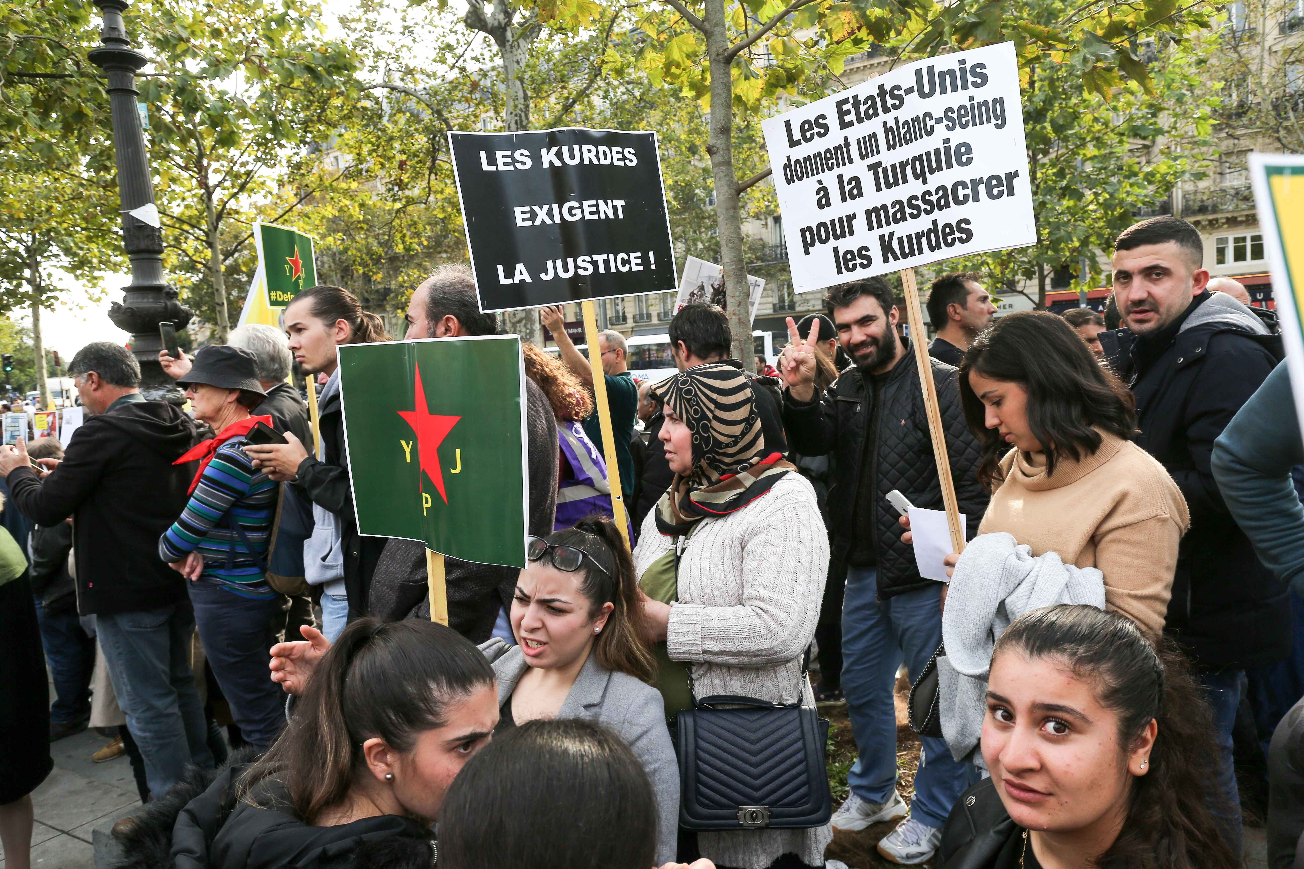 People gathered at the place de la Republique in Paris, on October 12, 2019, in support of the Kurds and against the Turkish offensive in Syria. On October 9, 2019, the Turkish military began its assault against Kurdish-held territory in northern Syria , p