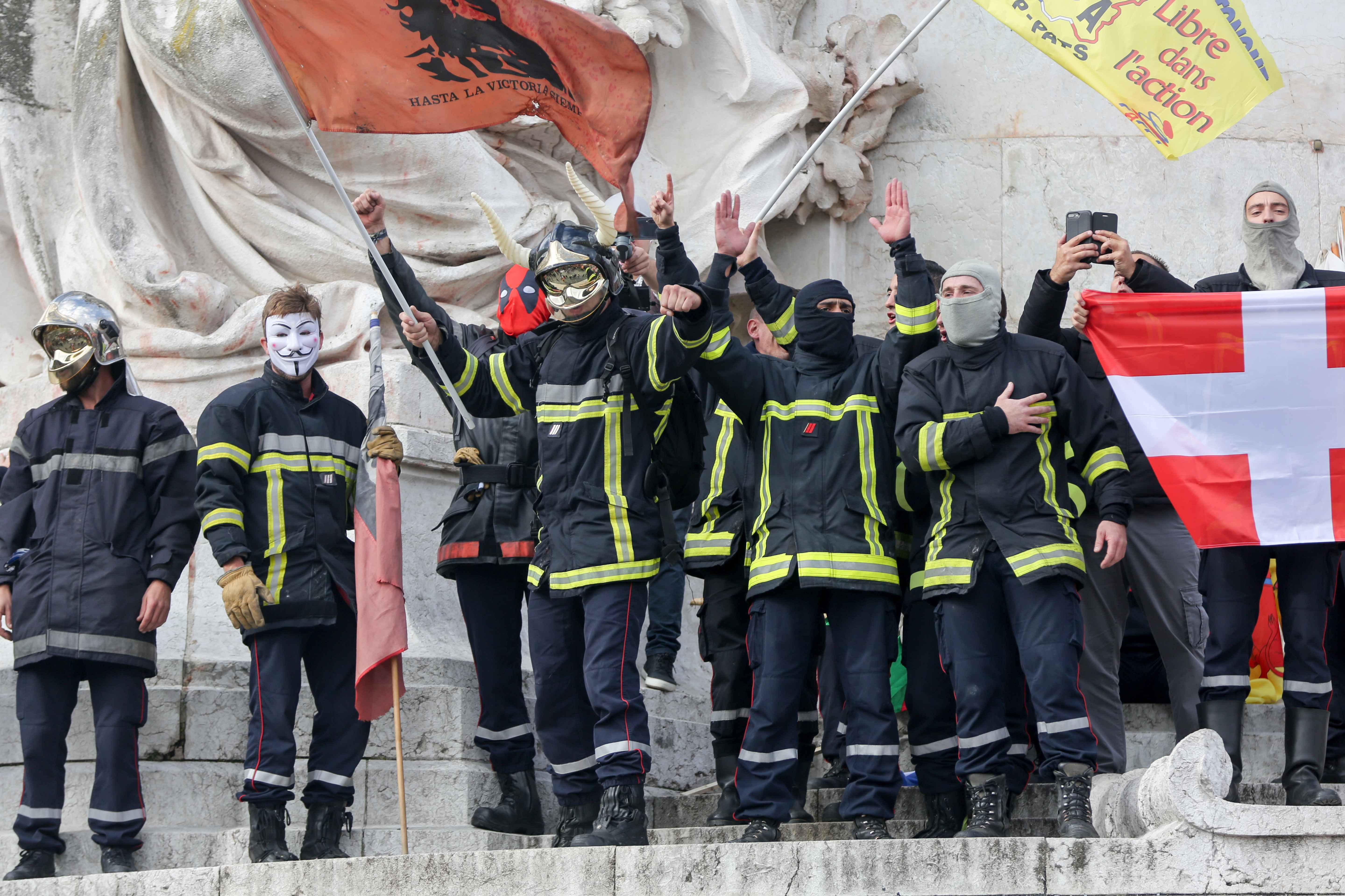 "Firefighters protest over the ""Republique"" statue on the place de la Republique, during the day of mobilization and national demonstration of the professional French firefighters in Paris, on October 15, 2019."