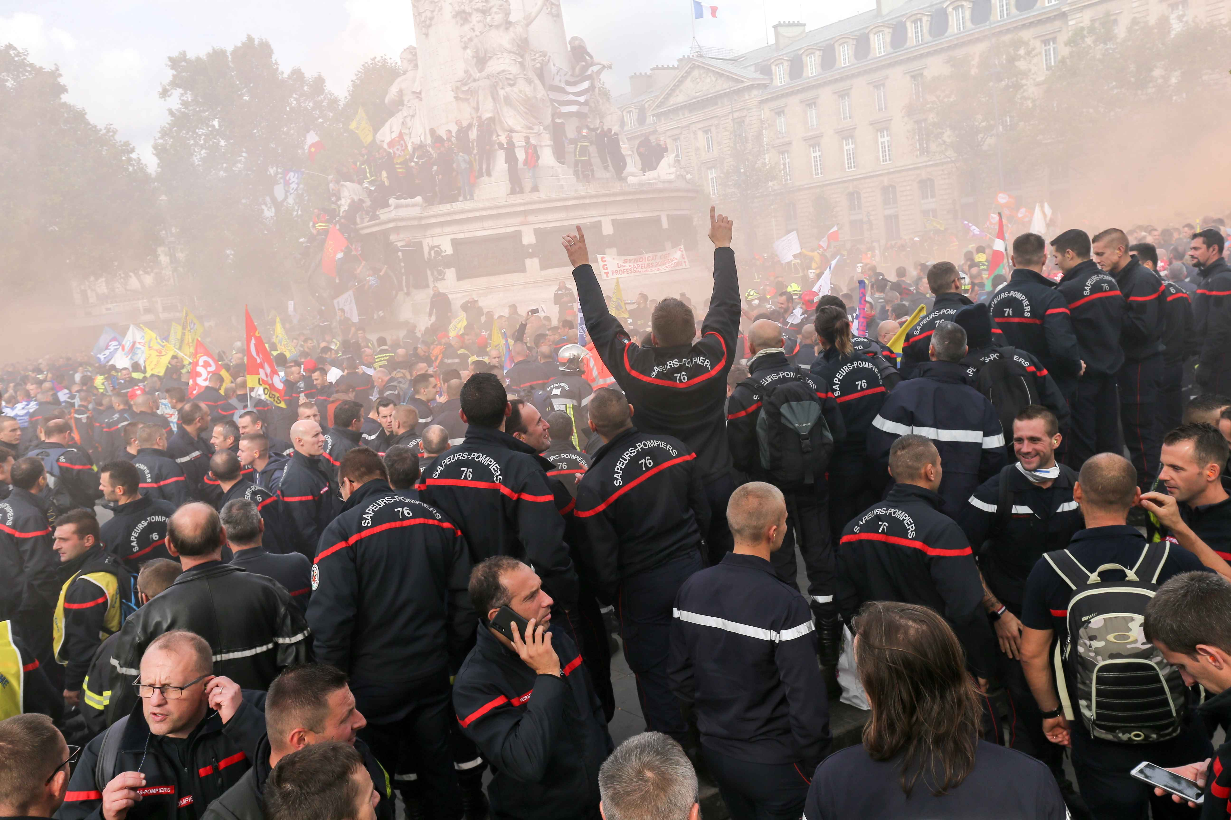 Firefighters protest at place de la Republique, during the day of mobilization and national demonstration of the professional French firefighters in Paris, on October 15, 2019.