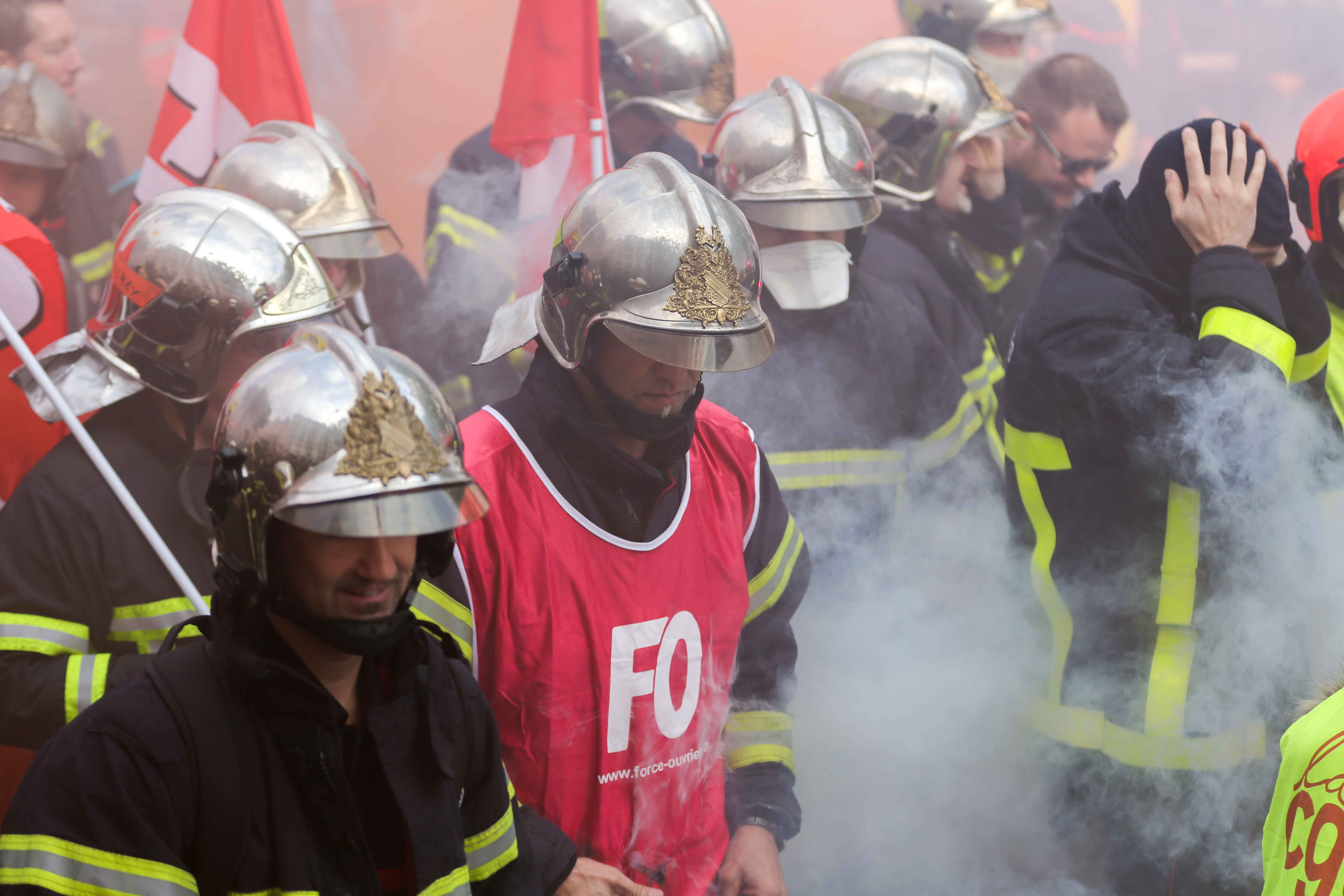 Firefighters protest as they march during the day of mobilization and national demonstration of the professional French firefighters in Paris, on October 15, 2019.