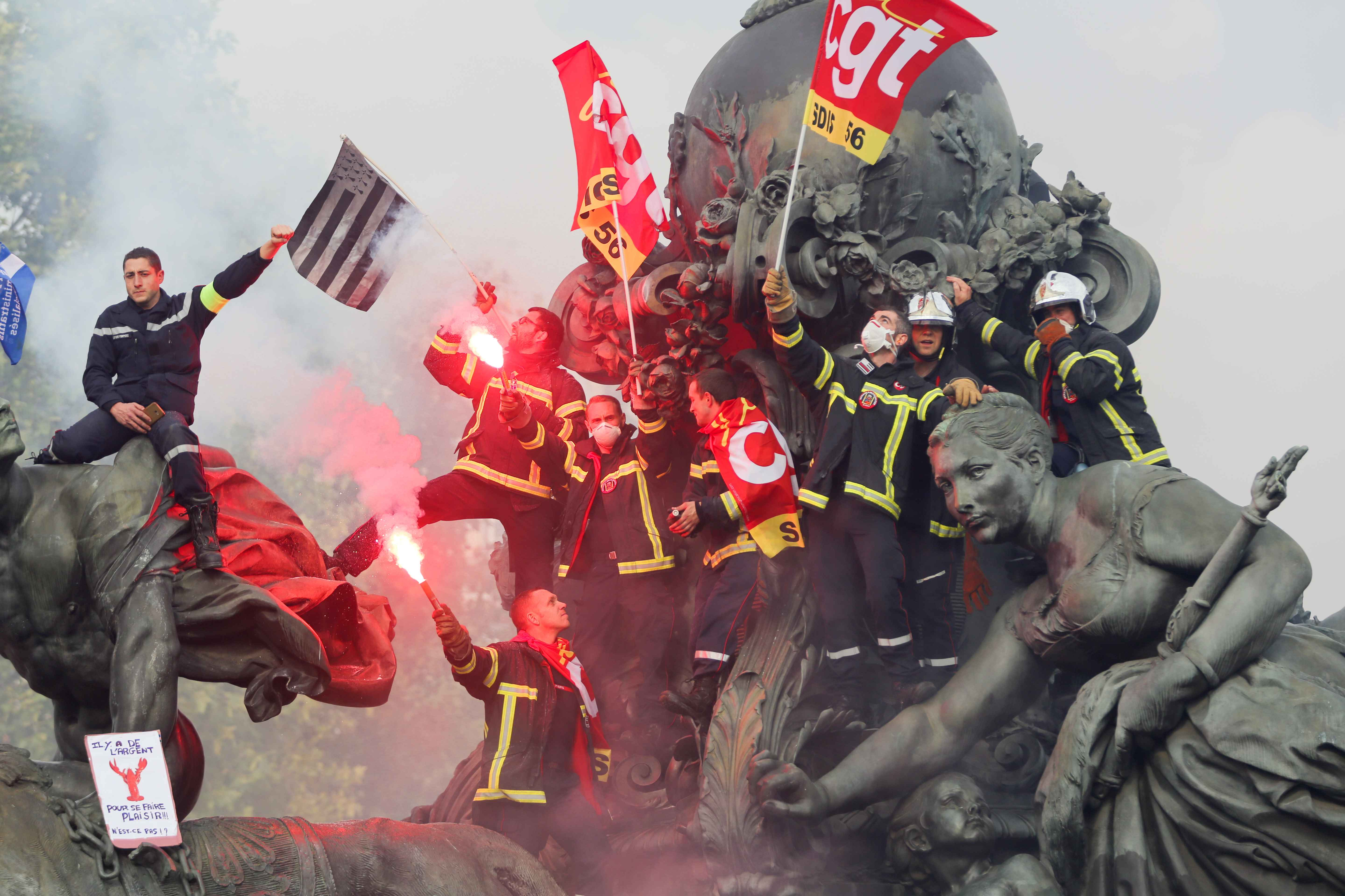 "Firefighters protest over the "" Le Triomphe de la Republique "" statue on the place de la Nation, during the day of mobilization and national demonstration of the professional French firefighters in Paris, on October 15, 2019."
