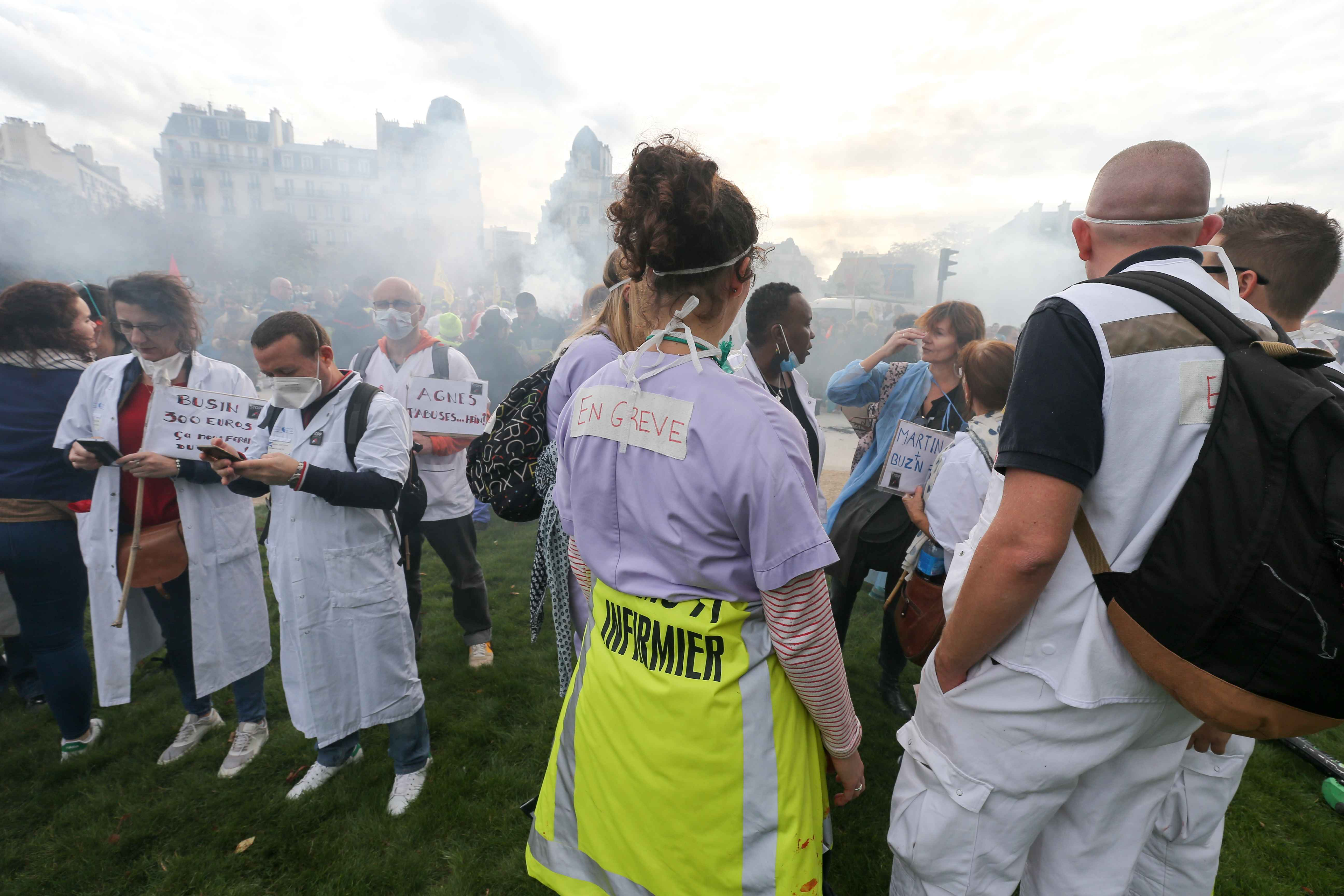 Hospital staff and firefighters protest as they march during the day of mobilization and national demonstration of the professional French firefighters in Paris, on October 15, 2019.
