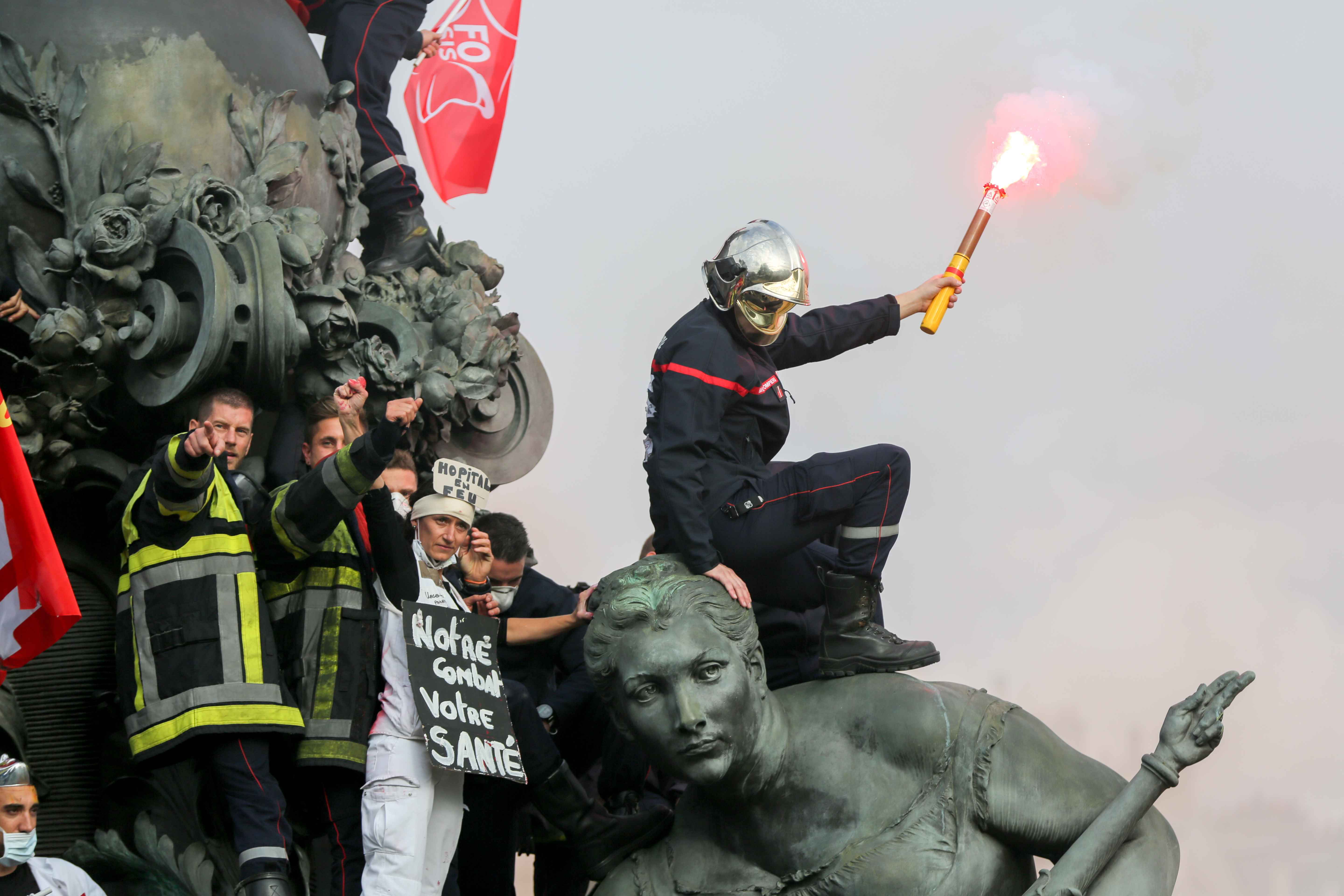 "Firefighters and hospital staff protest over the "" Le Triomphe de la Republique "" statue on the place de la Nation, during the day of mobilization and national demonstration of the professional French firefighters in Paris, on October 15, 2019."