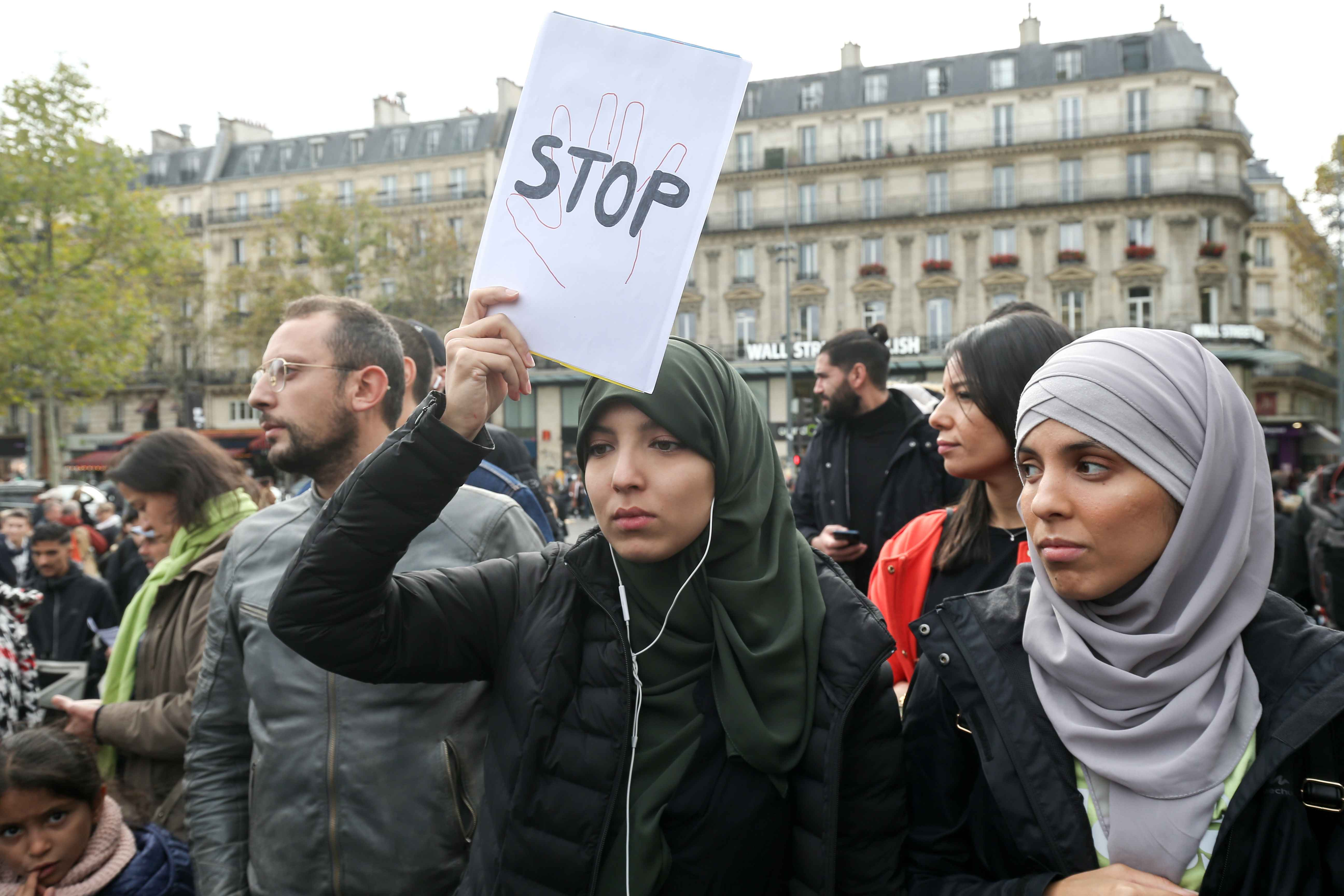 Women demonstrate against Islamophobia on October 19, 2019 on the place de la Republique in Paris. A new row over secularism and the wearing of the Islamic hijab in public buildings has erupted in France after a far-right politician asked a woman accompany