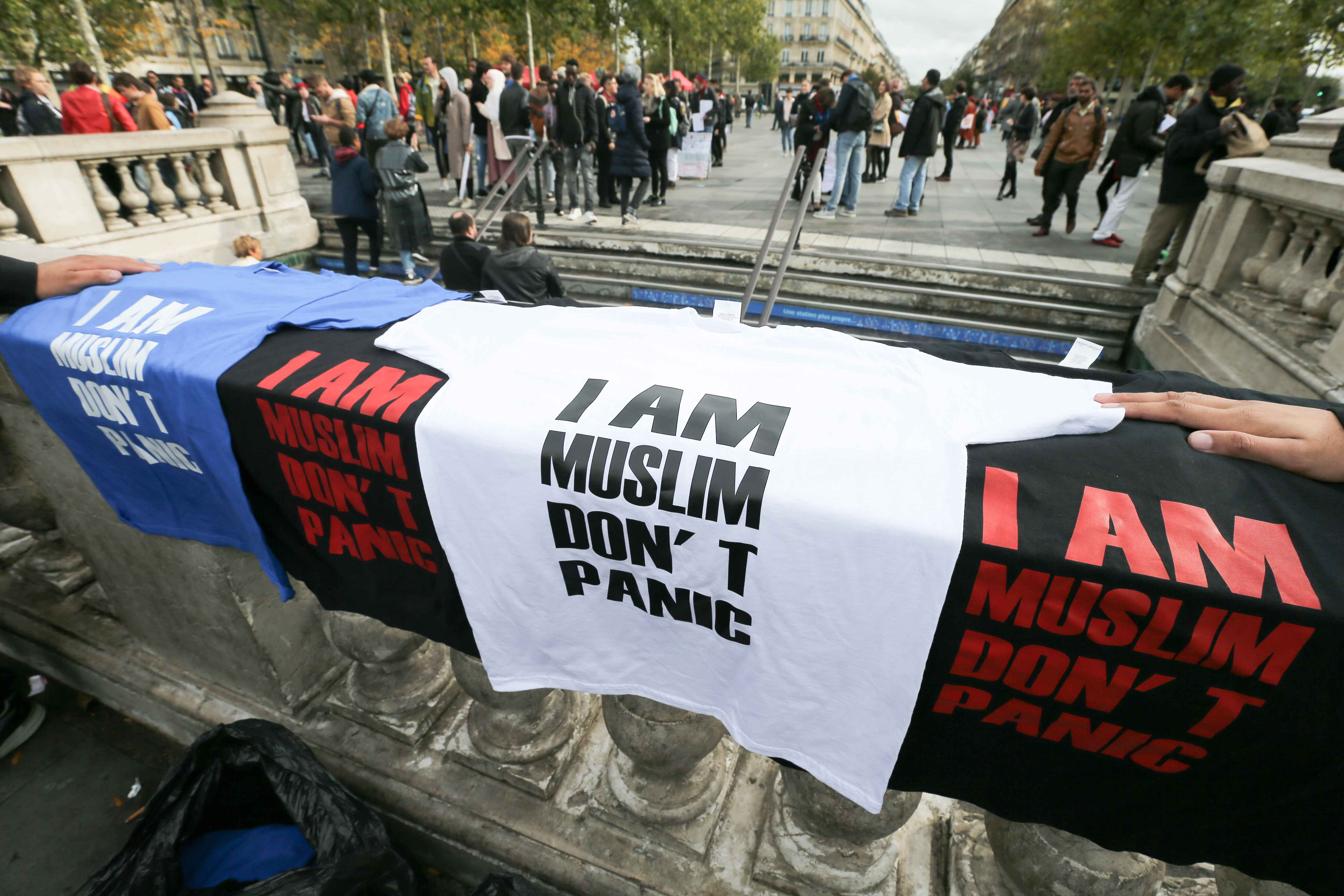 Shirts reading « I am Muslim, don't panic » are exhibited during a demonstration on October 19, 2019 on the place de la Republique in Paris. A new row over secularism and the wearing of the Islamic hijab in public buildings has erupted in France after