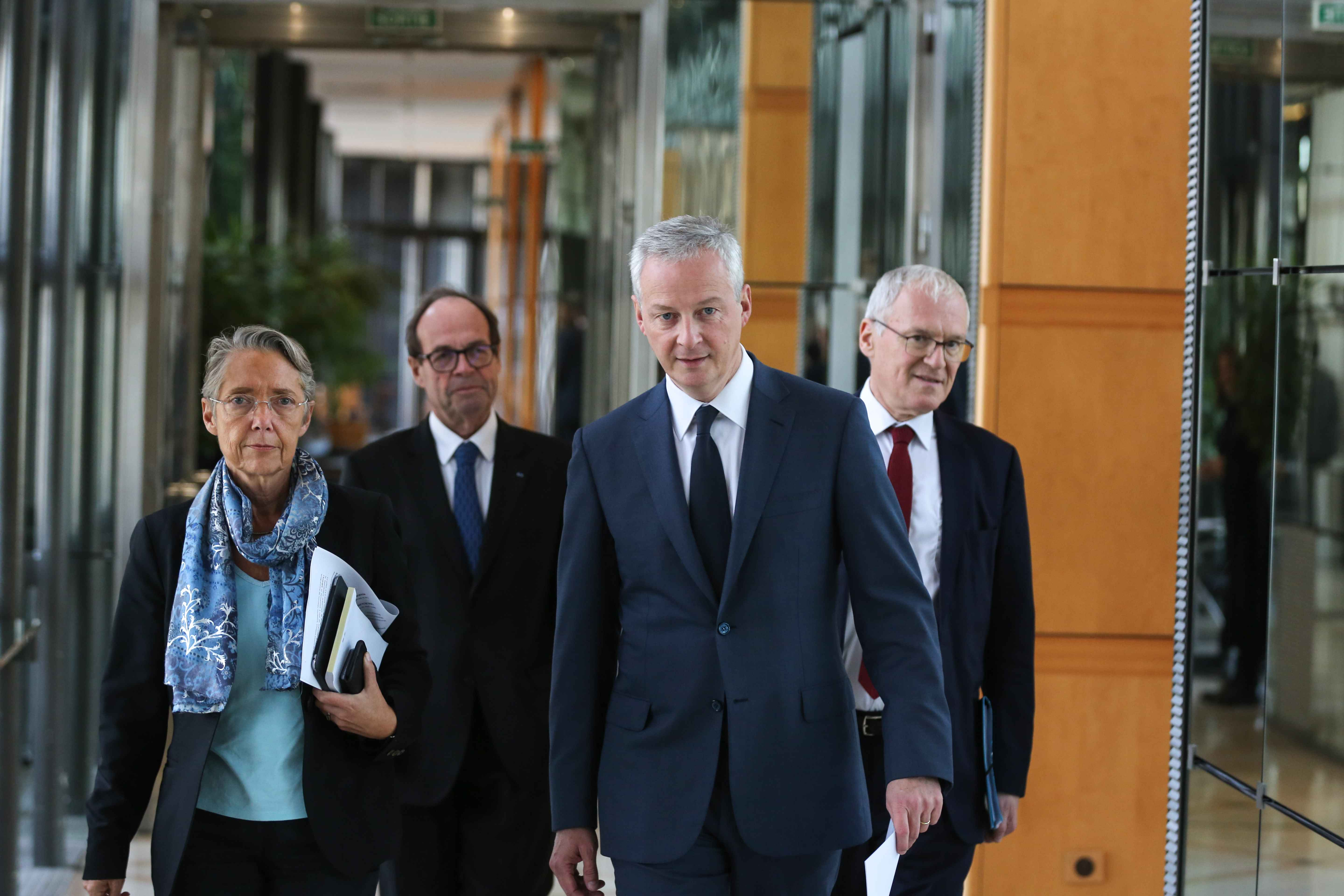 (From L to R) French Minister for the Ecological and Inclusive Transition Elisabeth Borne, report head Jean-Martin Folz, French Finance and Economy Minister Bruno Le Maire and French energy giant EDF's CEO Jean-Bernard Levy arrive at  a joint press confere