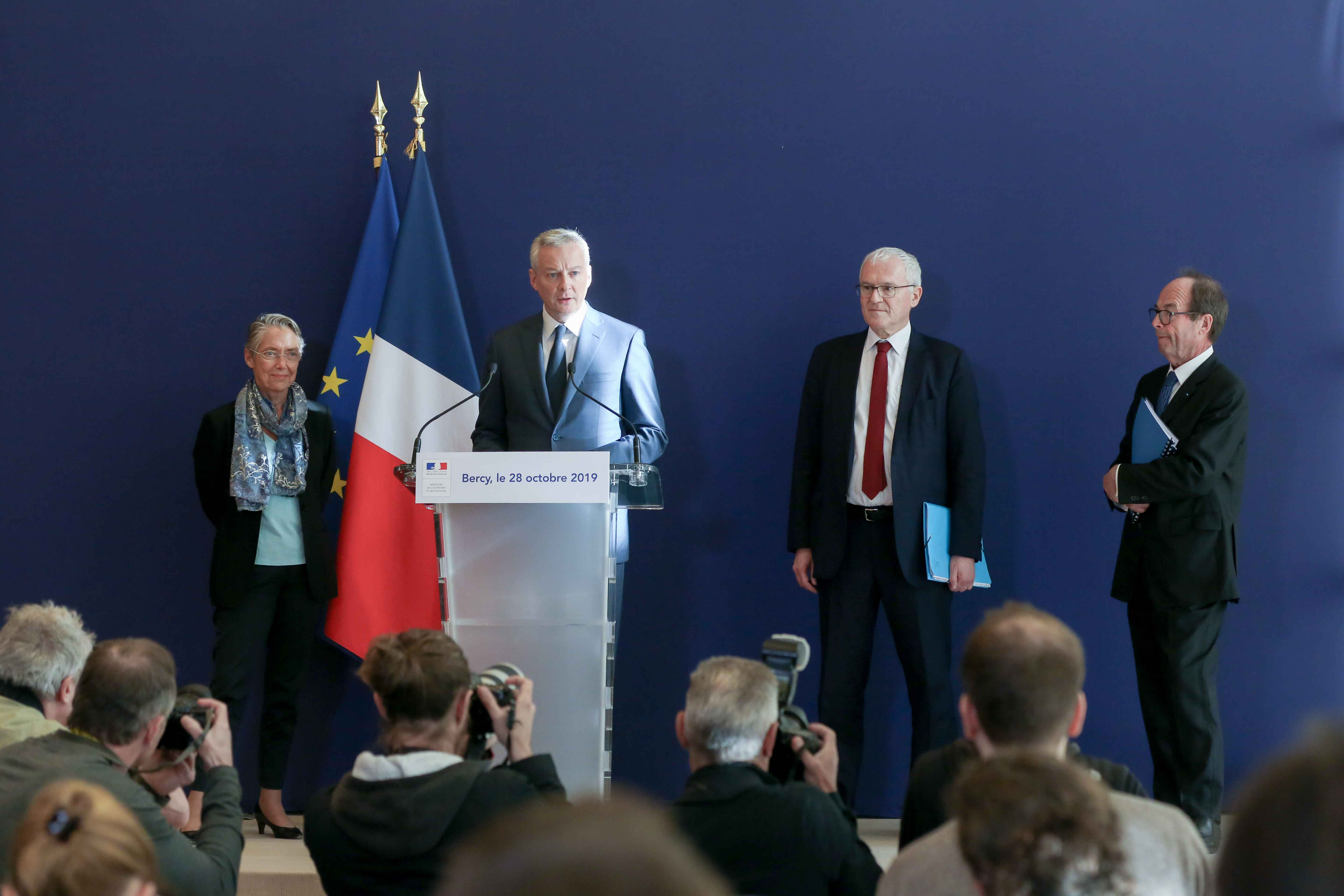 (From L to R) French Minister for the Ecological and Inclusive Transition Elisabeth Borne, French Finance and Economy Minister Bruno Le Maire, French energy giant EDF's CEO Jean-Bernard Levy and report head Jean-Martin Folz give a press conference to prese