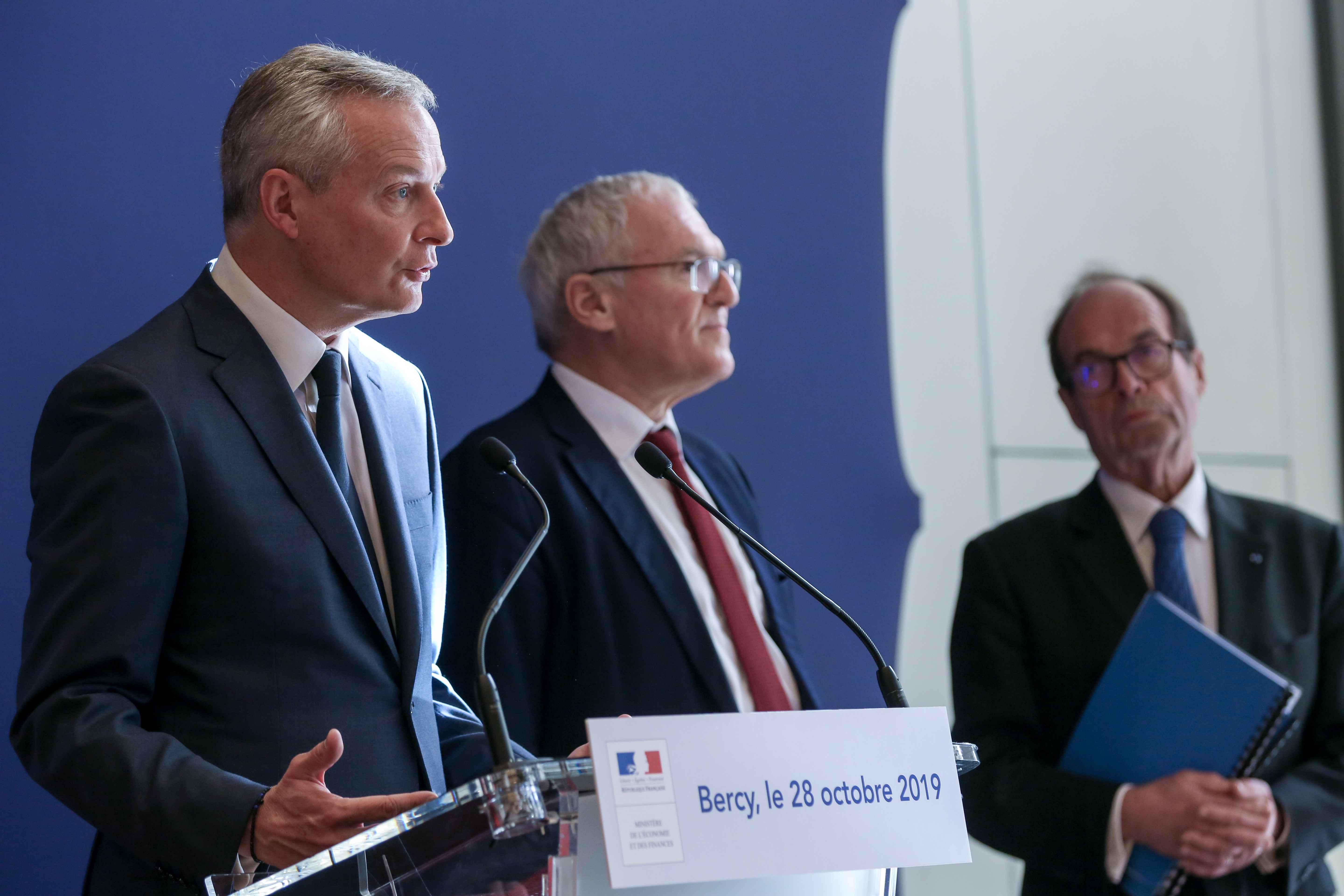 (From L to R) French Finance and Economy Minister Bruno Le Maire, French energy giant EDF's CEO Jean-Bernard Levy report head Jean-Martin Folz give a press conference to present a report concerning the construction of the EPR at the Flamanville nuclear pla