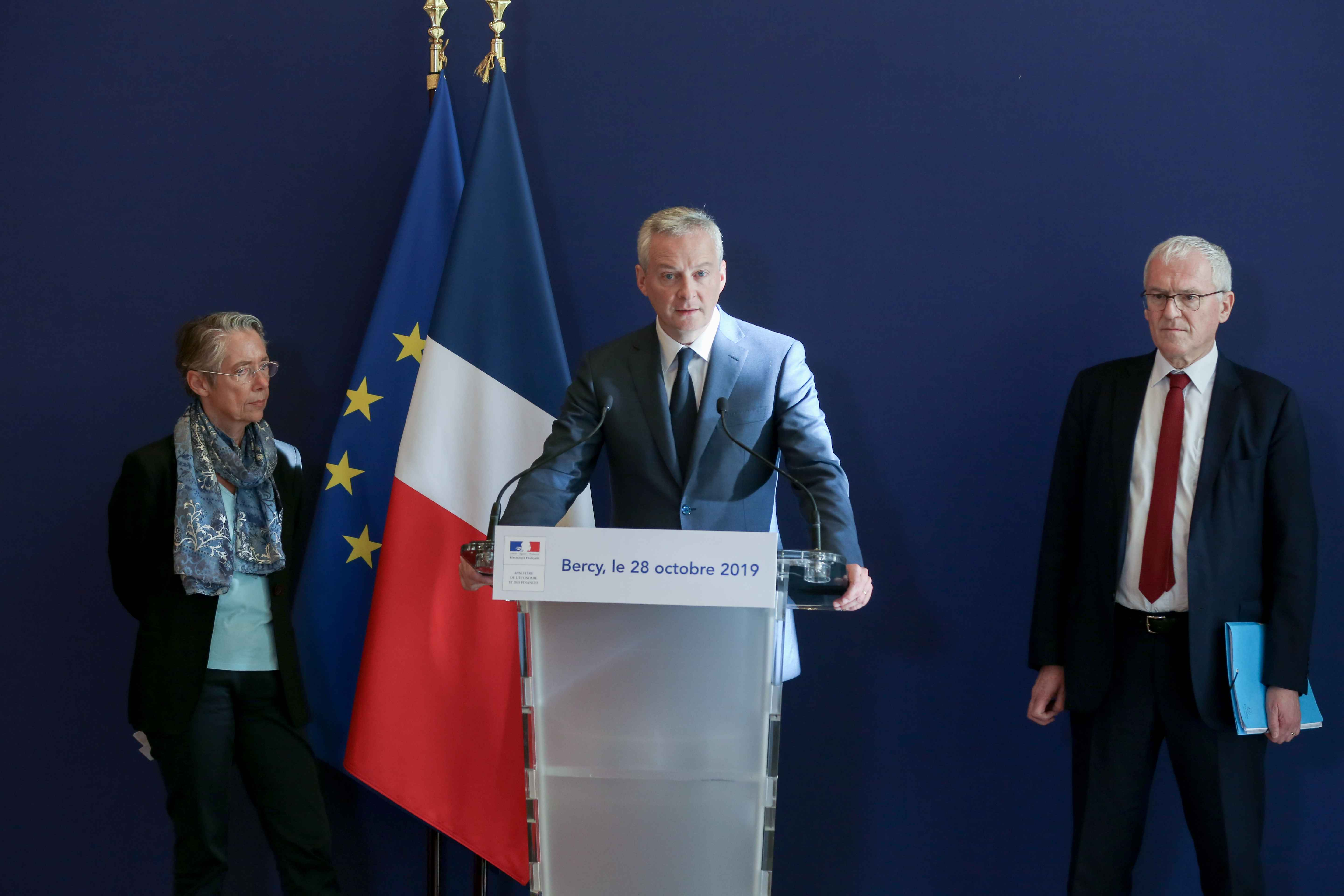 (From L to R) French Minister for the Ecological and Inclusive Transition Elisabeth Borne, French Finance and Economy Minister Bruno Le Maire and French energy giant EDF's CEO Jean-Bernard Levy give a joint press conference to present a report concerning t