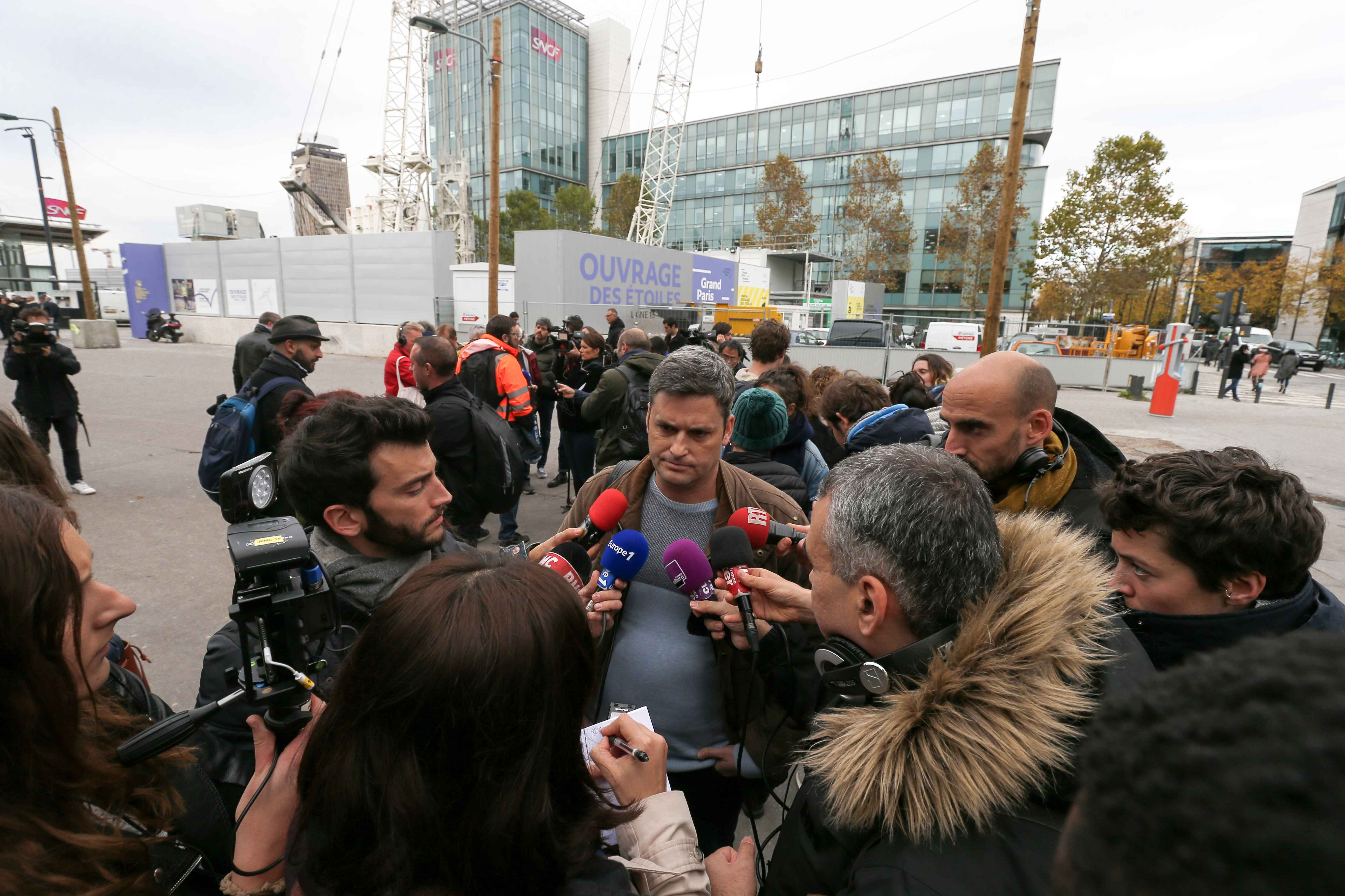 Railway worker of the France's national state-owned railway company (SNCF) from the Technicentre Chatillon TGV Technicentre speaks with press as he protests in front of the headquarters of the SNCF company, in Saint-Denis, near Paris, on October 29, 2019.