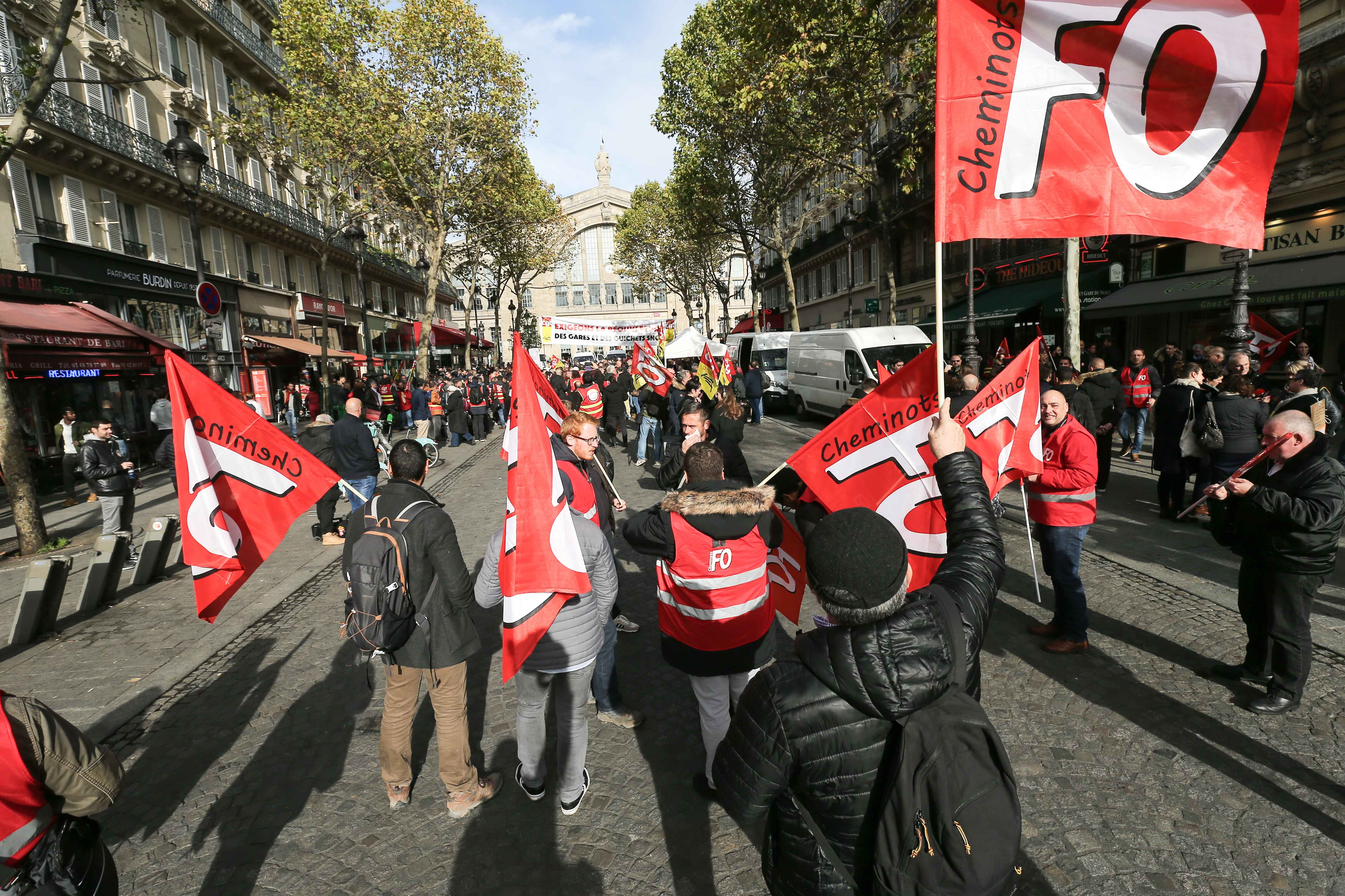 The FO union railway workers gather during a demonstration of employees of the state-owned rail operator SNCF called by CG union on November 5, 2019 in front of the Gare du Nord in Paris to defend SNCF's internal public service, denounce their living and w