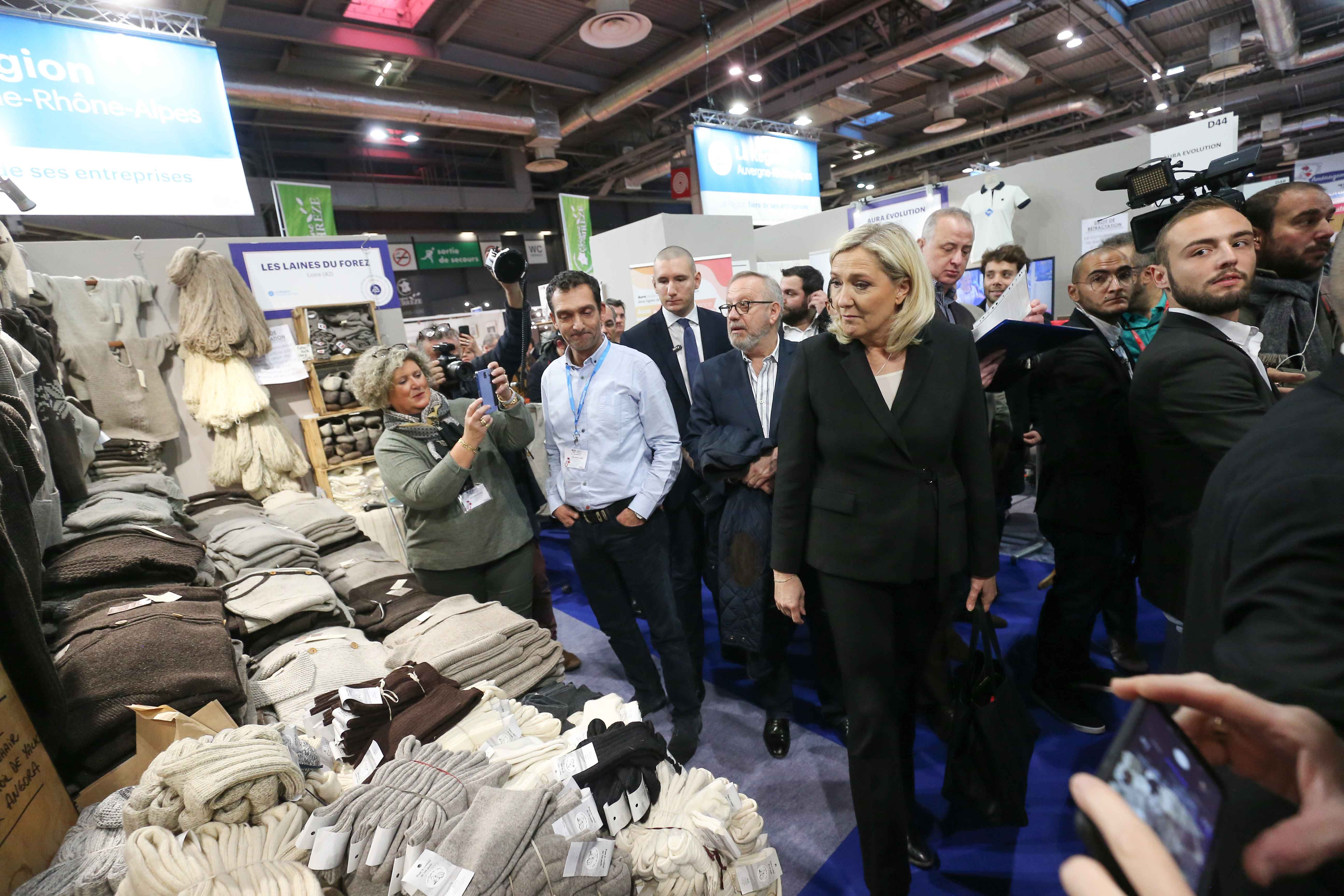 French far-right Rassemblement National (RN) party's president and MP Marine Le Pen (C) visits the Made in France Fair, on November 9, 2019, at the Porte de Versailles, in Paris.