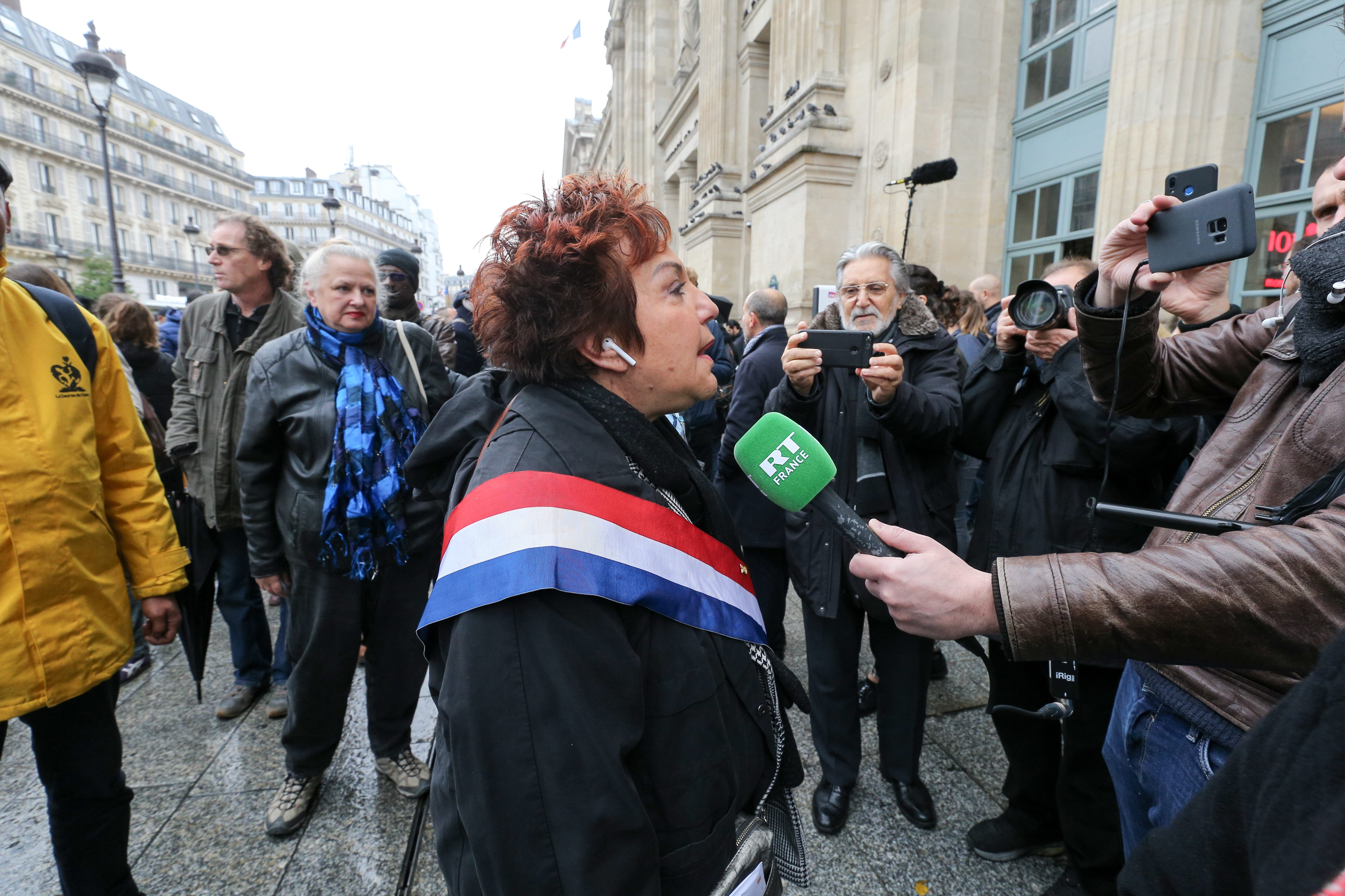 French-Turkish-Israeli hsitorian and ecologist politician Esther Benbassa (C) speaks with the press as she takes part in a march near the Gare du Nord, in Paris, on November 10, 2019, to protest against Islamophobia, at the call of several anti-racist acti