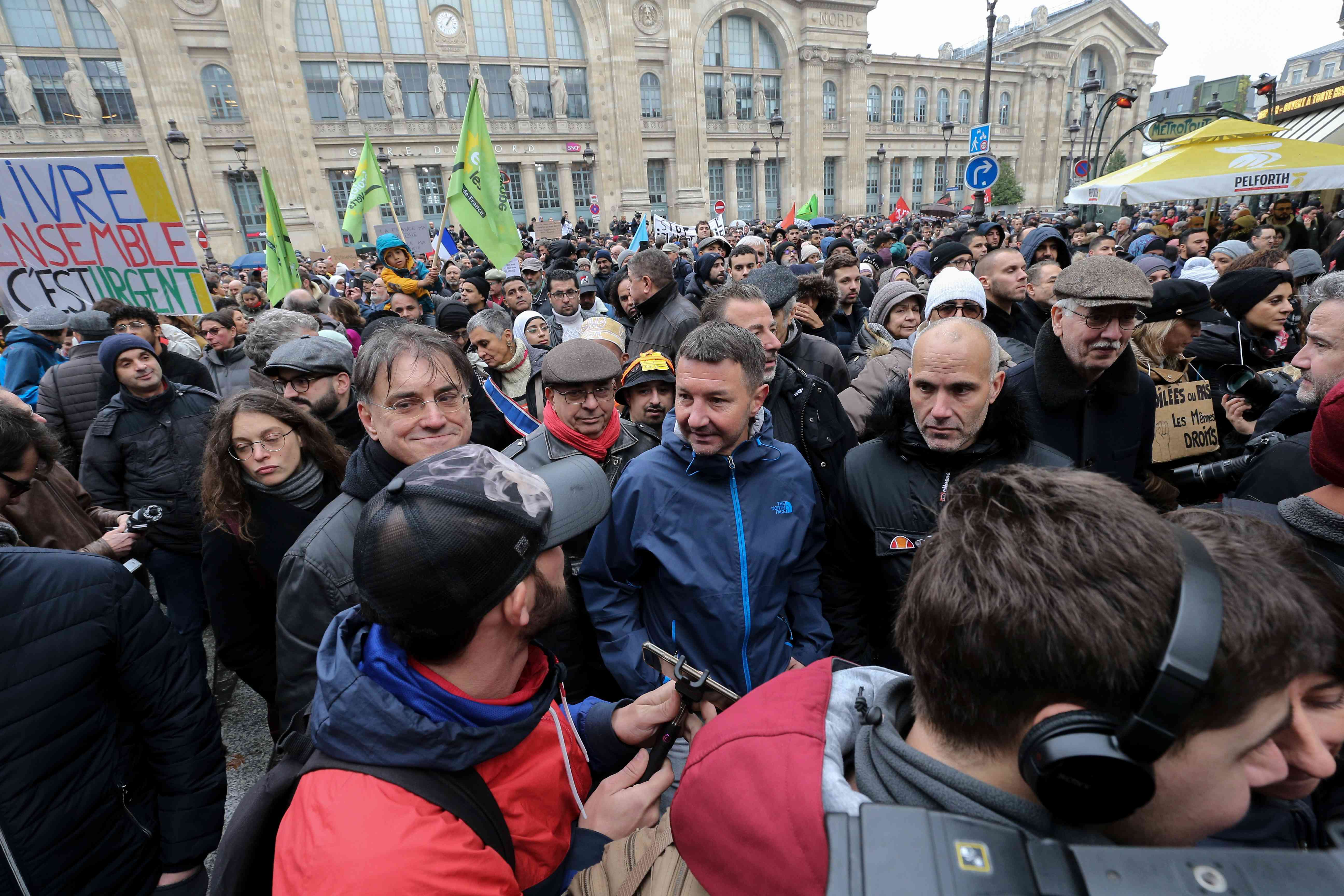 French far-left New Anti-Capitalist Party (NPA) member Olivier Besancenot (C) takes part in a march near the Gare du Nord, in Paris, on November 10, 2019, to protest against Islamophobia, at the call of several anti-racist activists and collectives.