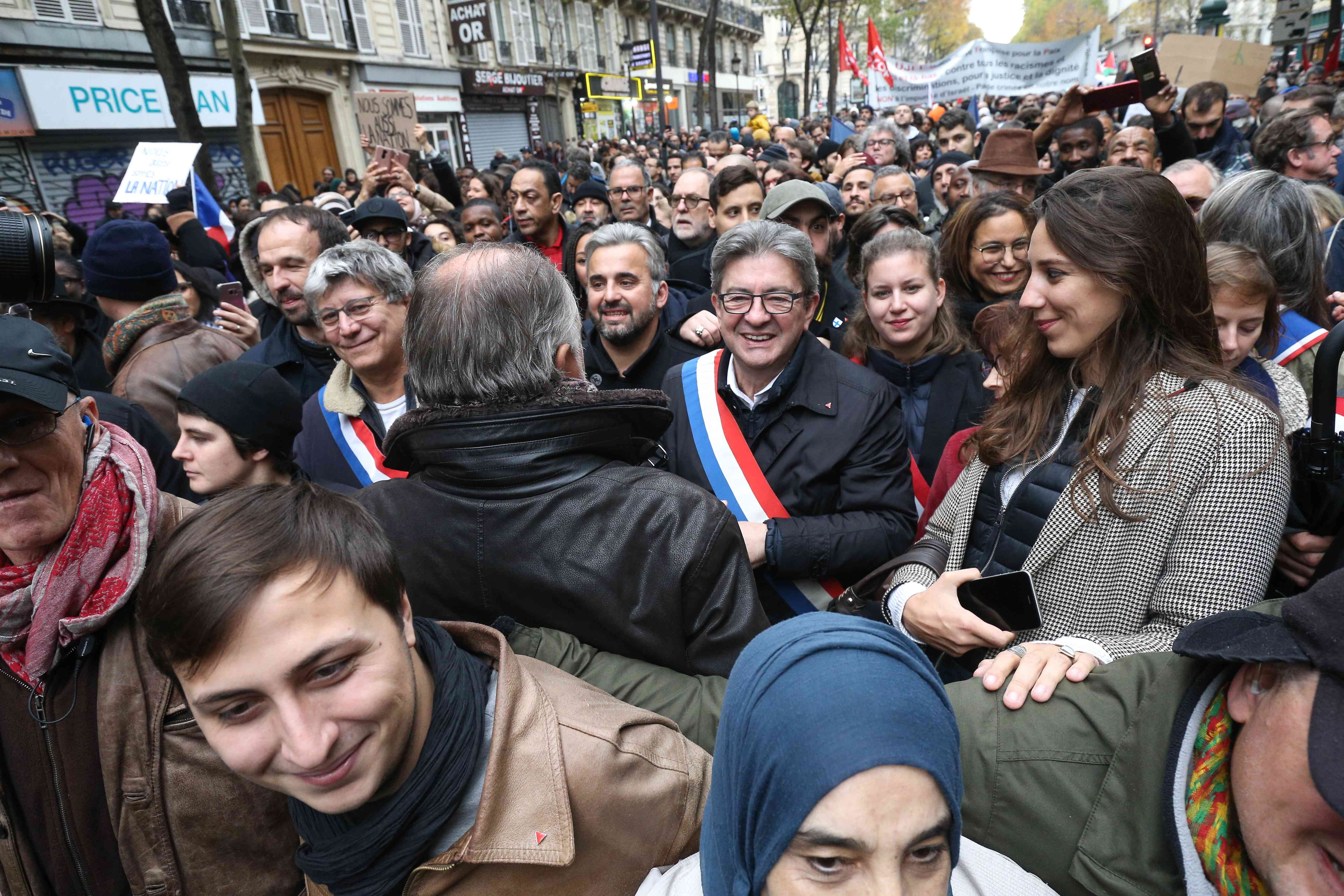 Head of La France Insoumise (LFI) left-wing party Jean-Luc Melenchon (C) takes part in a march near the Gare du Nord, in Paris, on November 10, 2019, to protest against Islamophobia, at the call of several anti-racist activists and collectives.