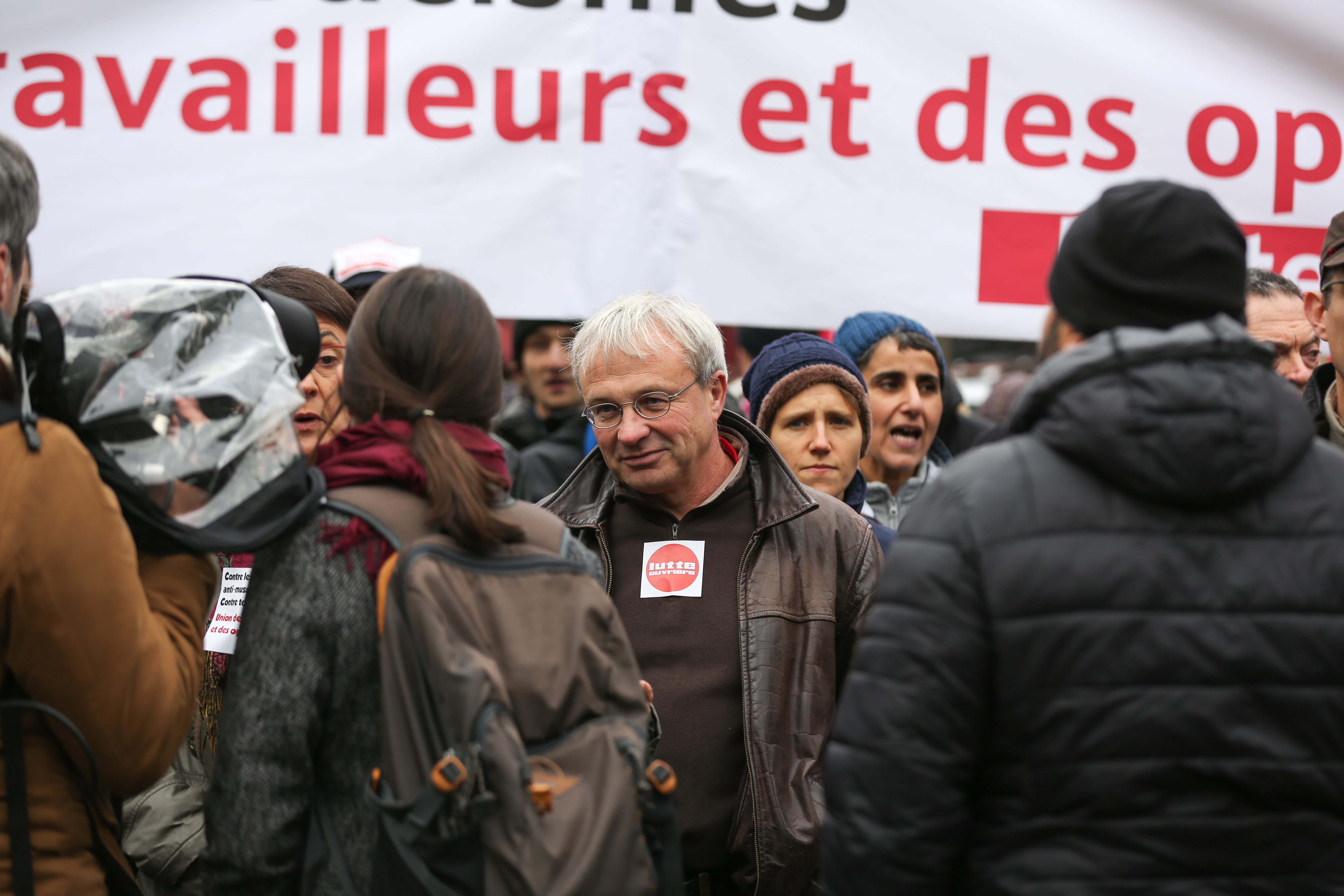 Far-left Lutte ouvriere (LO) former party candidate for the European election Jean-Pierre Mercier (C) takes part in a march near the Gare du Nord, in Paris, on November 10, 2019, to protest against Islamophobia, at the call of several anti-racist activists