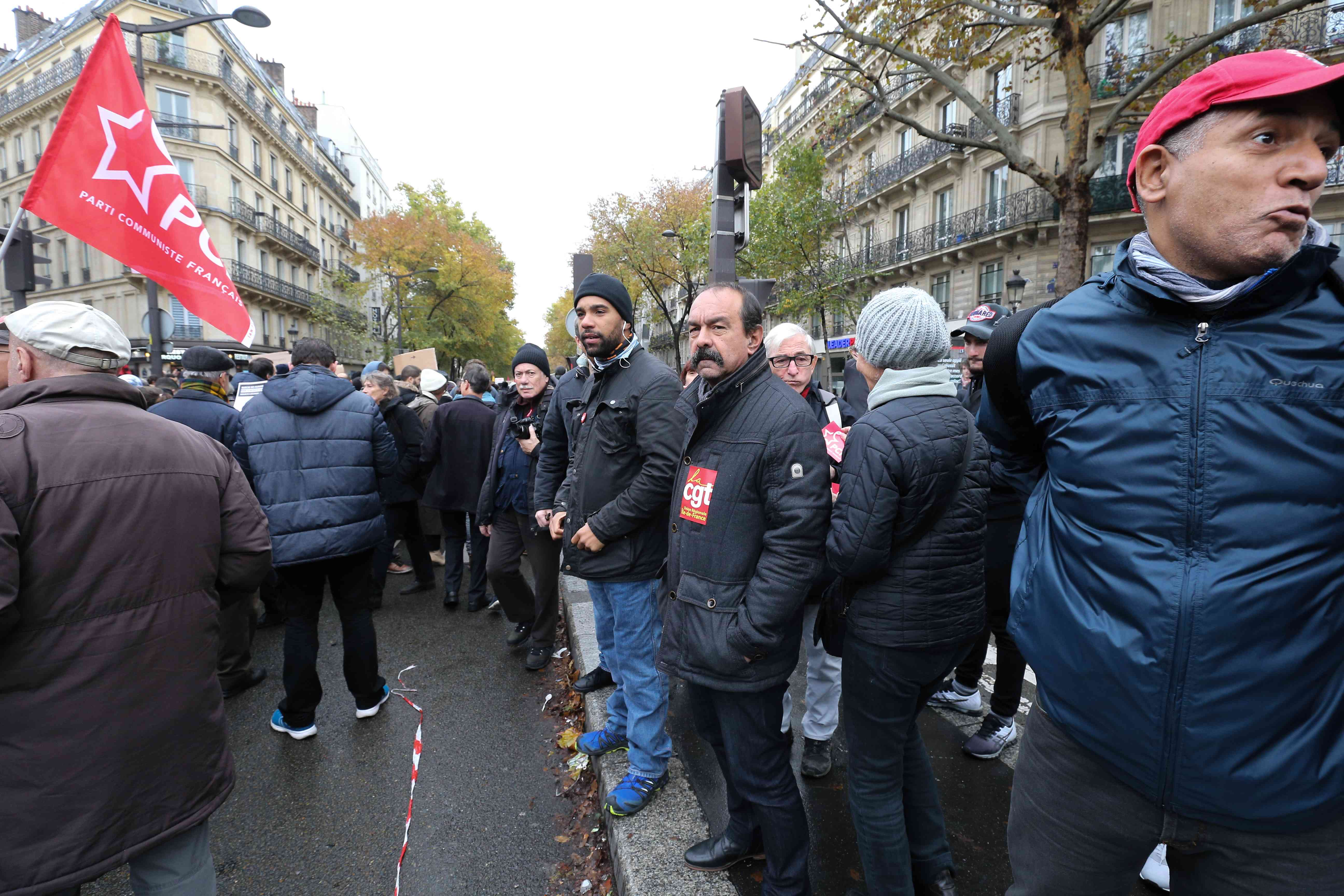 General Secretary of CGT union Philippe Martinez (3R) takes part in a march near the Gare du Nord, in Paris, on November 10, 2019, to protest against Islamophobia, at the call of several anti-racist activists and collectives.