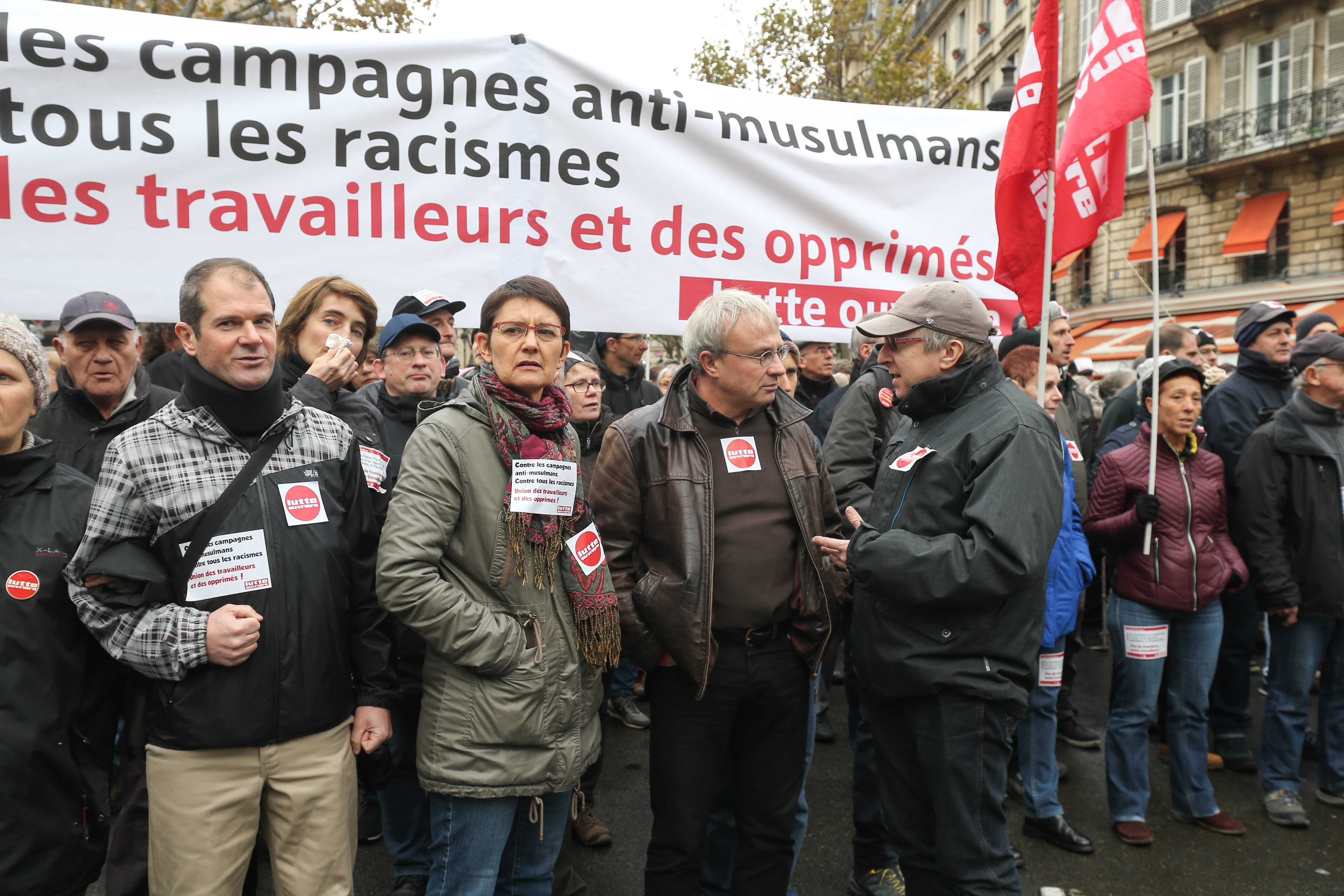 Nathalie Arthaud (6L), speaker for the far-left Lutte ouvriere (LO) and former candidate for the European election Jean-Pierre Mercier (7L) take part in a march near the Gare du Nord, in Paris, on November 10, 2019, to protest against Islamophobia, at the
