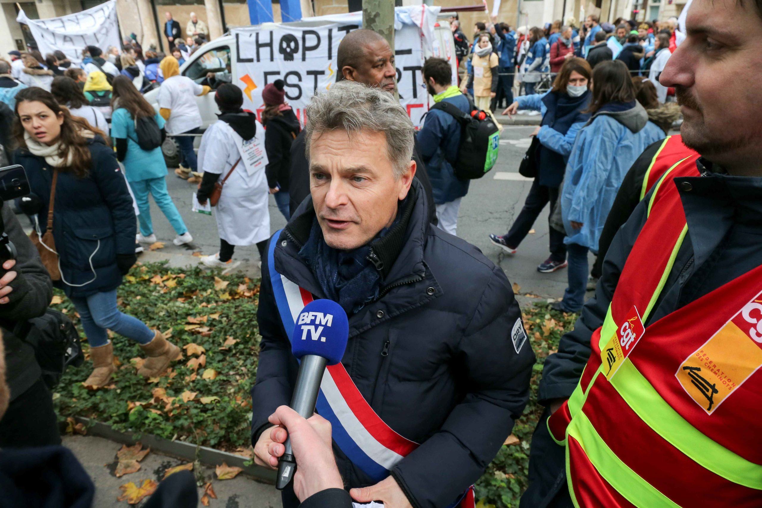 "Communist party member of Parliament Fabien Roussel (C) takes part in a demonstration of professionnals from french public hospitals in Paris on November 14, 2019, for another day of action as part of a nationwide day of protest calling for an ""emergency p"