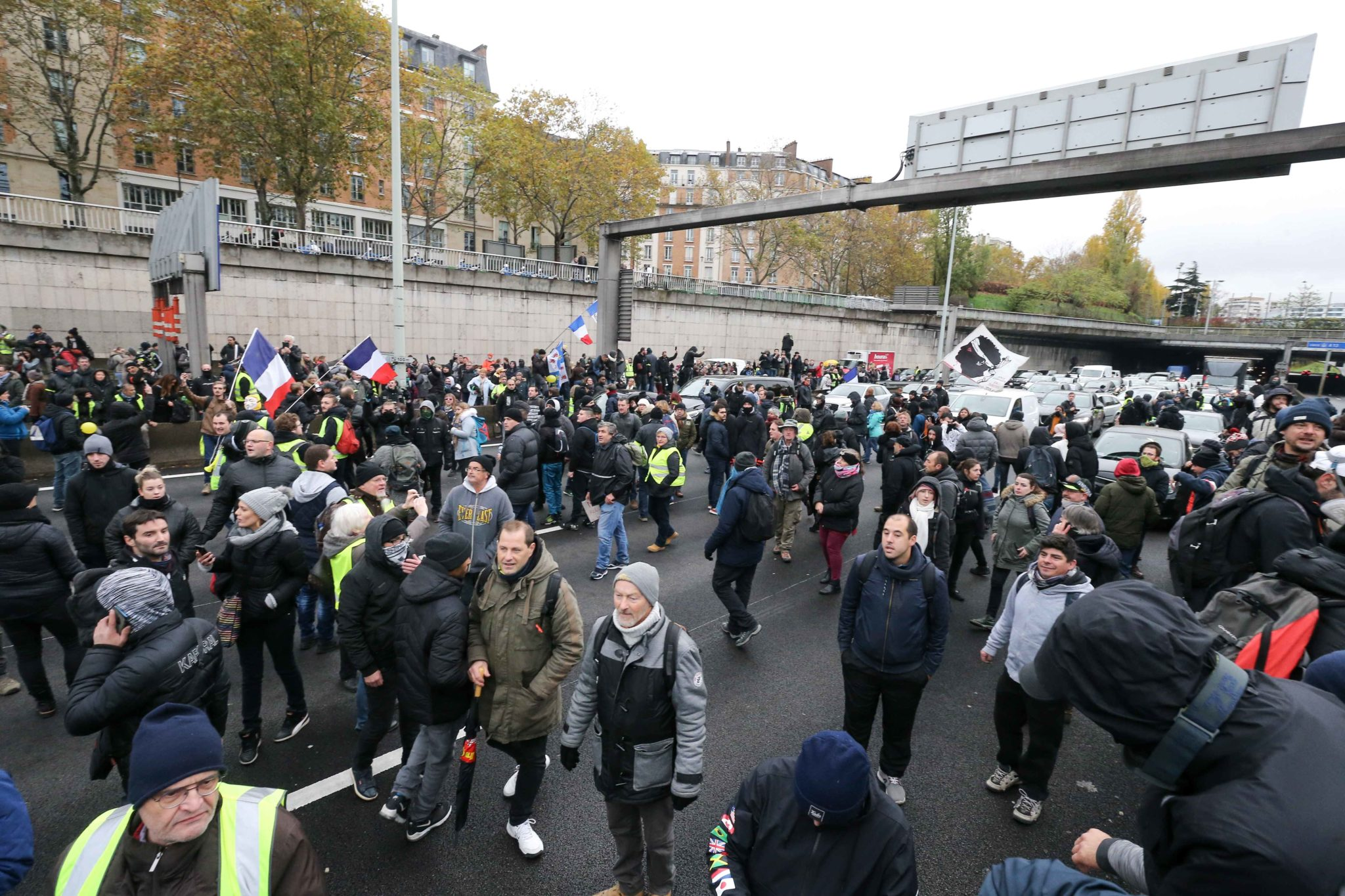 "Members of the ""yellow vest"" (gilets jaunes) movement block the traffic Porte de Champerret on Paris ring-road on November 16, 2019, to celebrate the first anniversary of the movement. French ""yellow vest"" protesters are planning a series of nationwide dem"